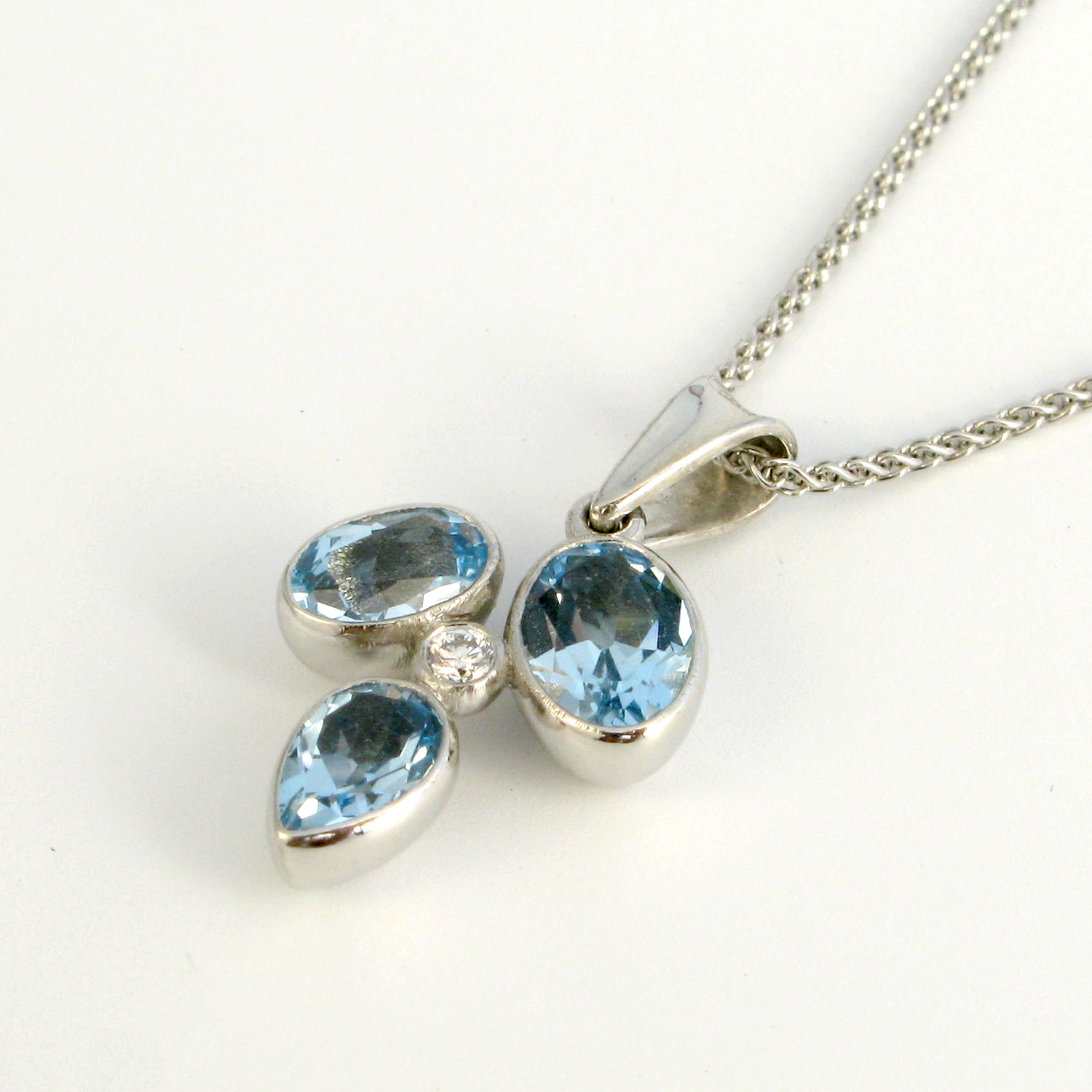 18k White Gold Mini 'Kaleidoscope' Necklace with Sky Blue Topazes and a Diamond by Pratima Design Fine Art Jewelry