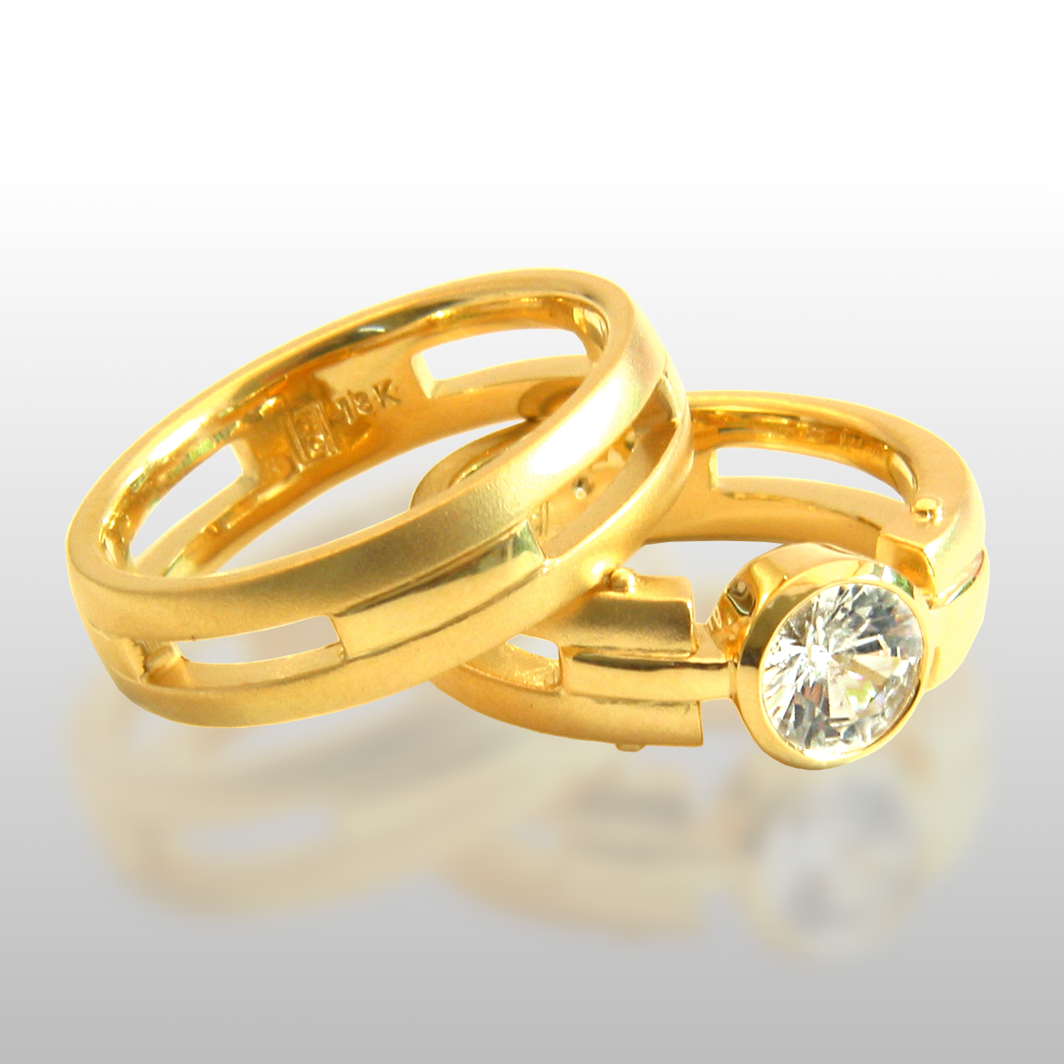 His and hers matching contemporary 18k gold wedding band set 'Millennium' with a 1ct diamond by Pratima Design Fine Art Jewelry