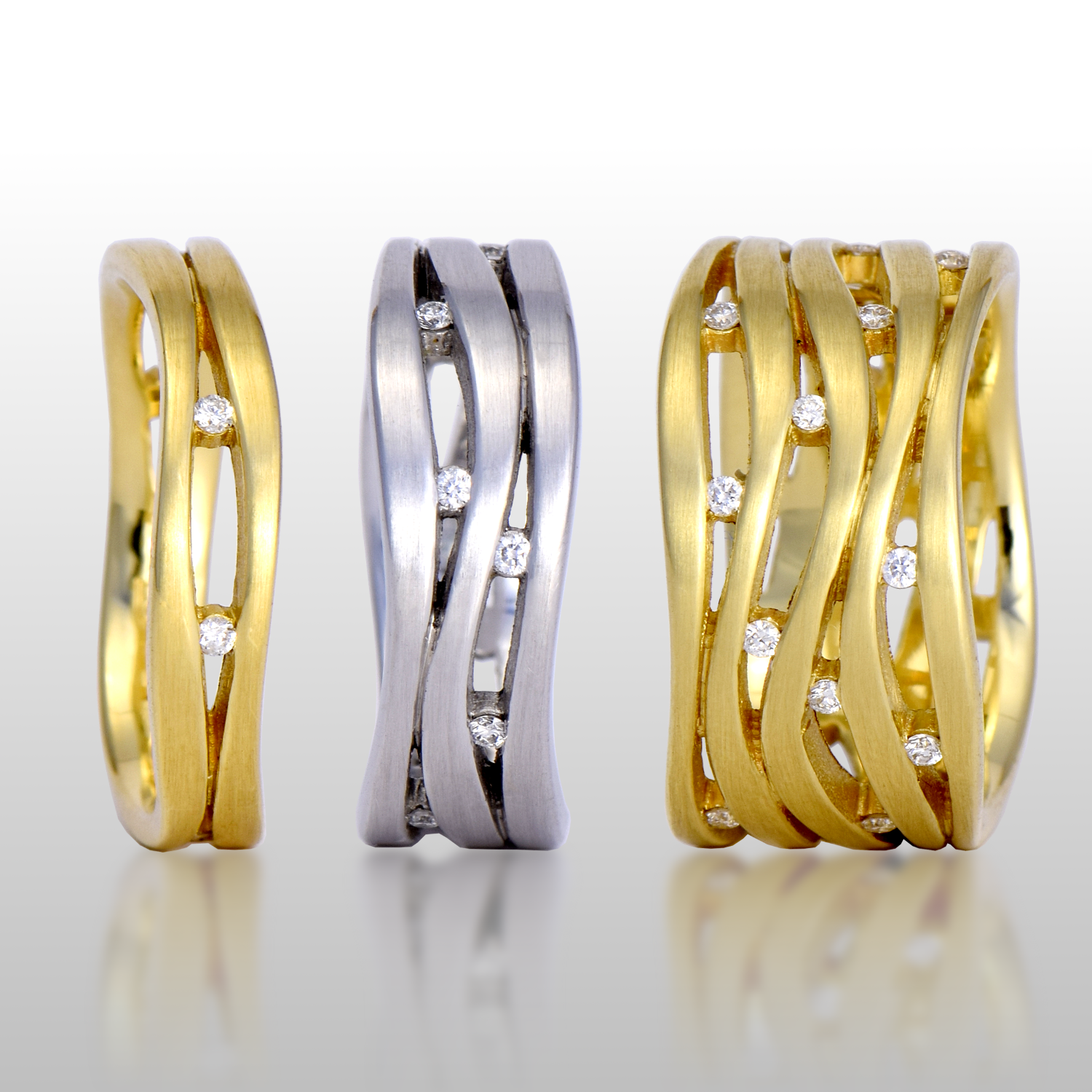 Wave rings in 18k gold or platinum 'Lamello' with diamonds by Pratima Design Fine Art Jewelry