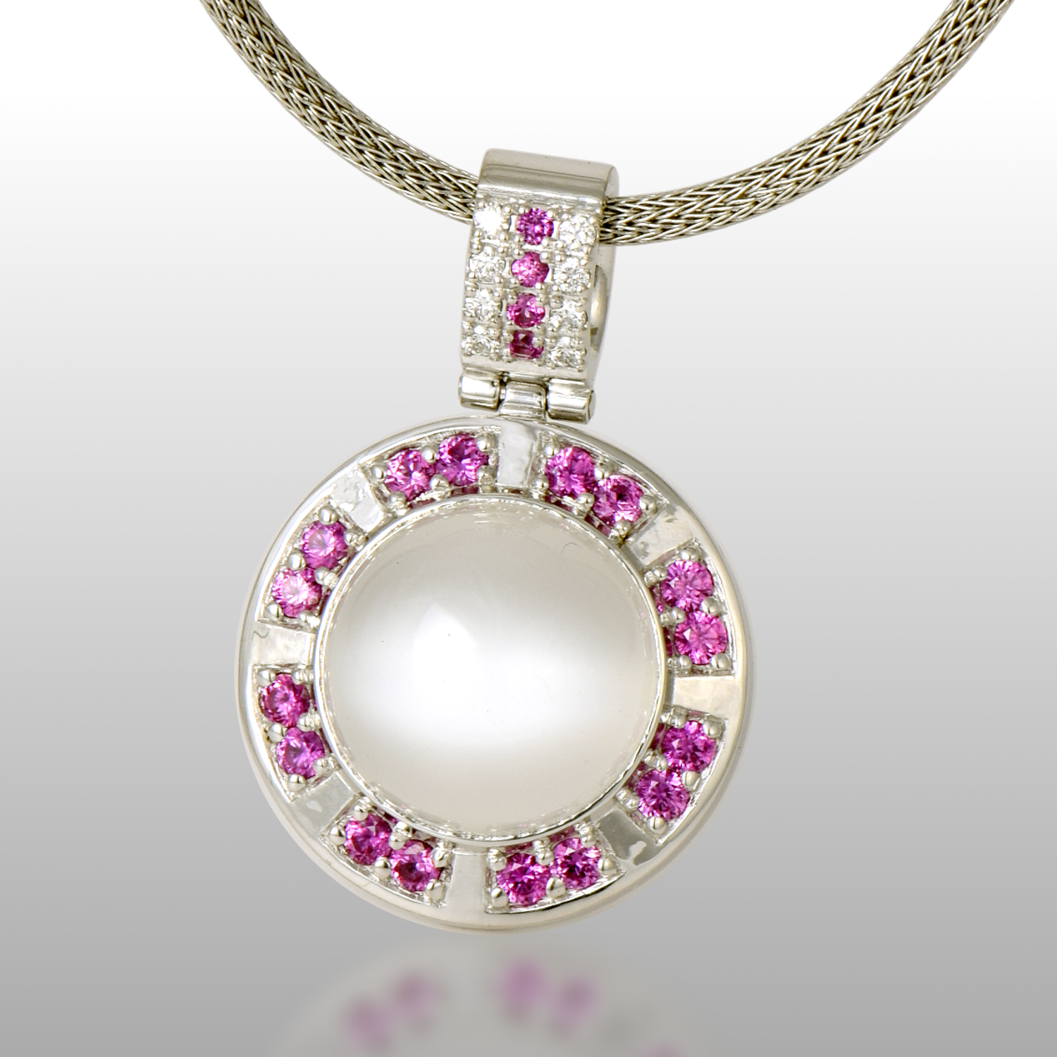 Contemporary Moonstone Pendant 'Orbit' in 18k White Gold with Diamonds and Pink Sapphires by Pratima Design Fine Art Jewelry