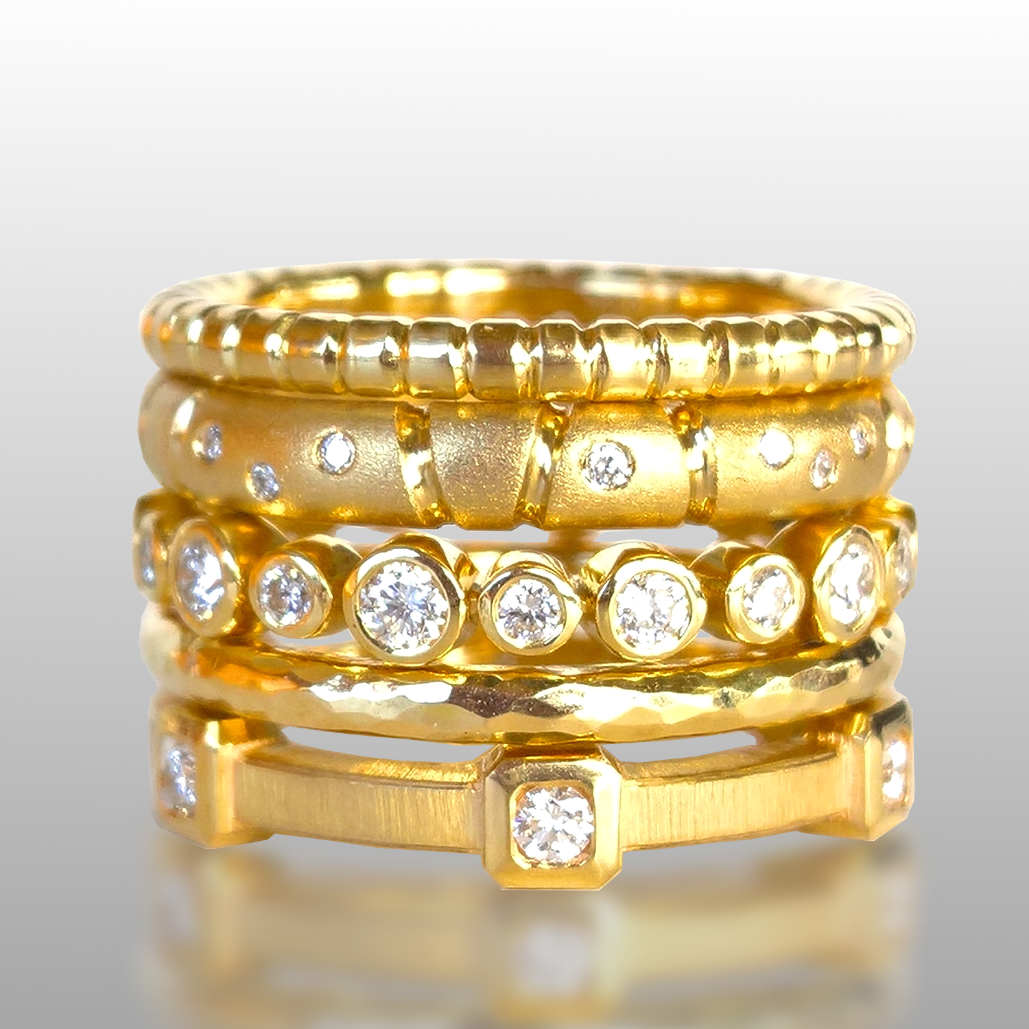 Collectible Diamond Stacking Rings in 22k and 18k Gold from the 'MOMENTI' Collection by Pratima Design Fine Art Jewelry