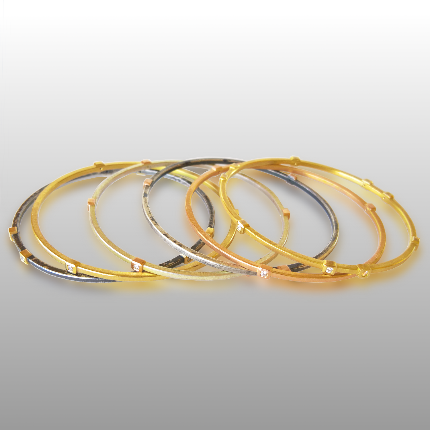 Stackable Diamond Bangles in 18k Gold and Silver by Pratima Design Fine Art Jewelry Maui