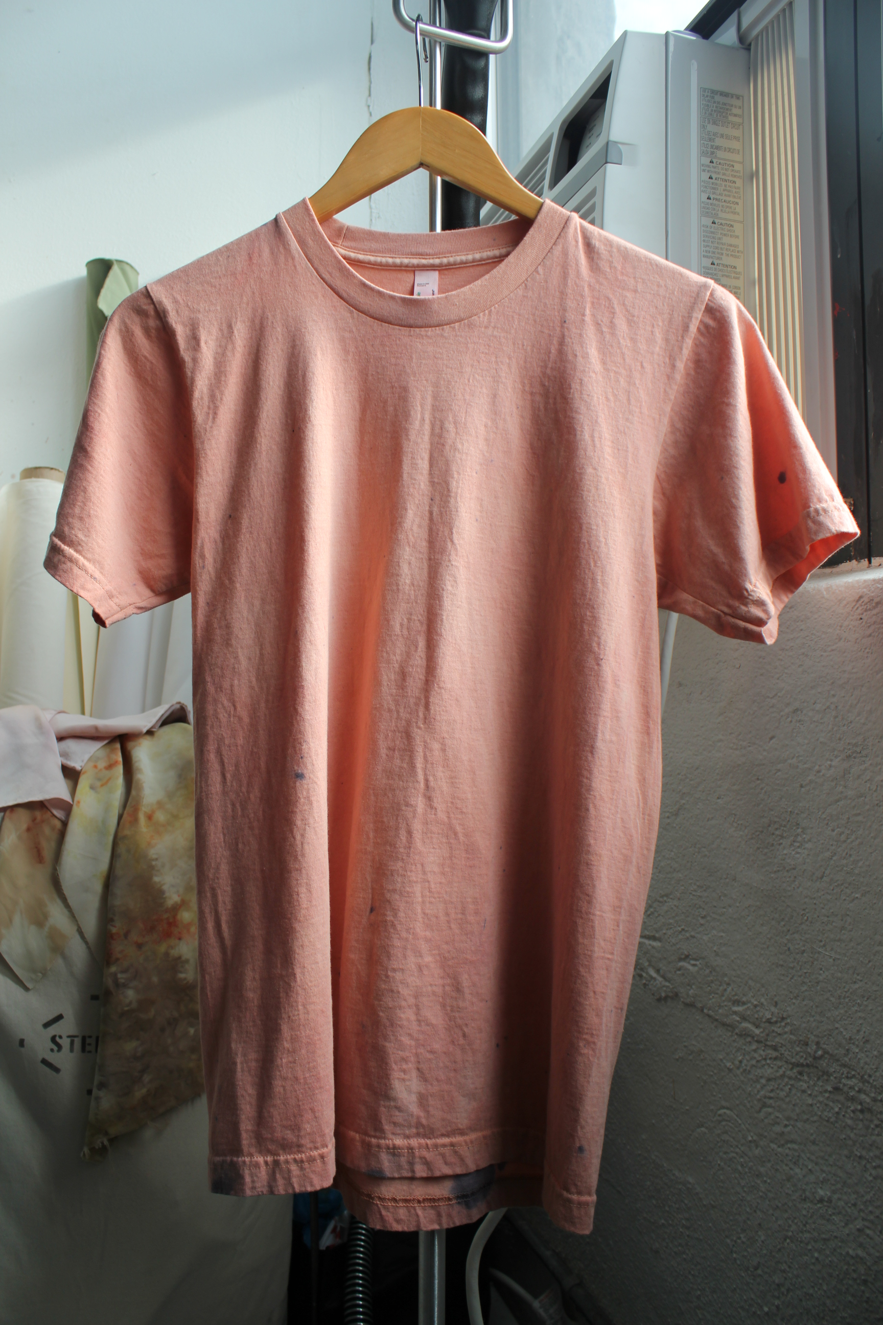 A t-shirt dyed with madder root. The spots come from iron remnants left in the dye vat.