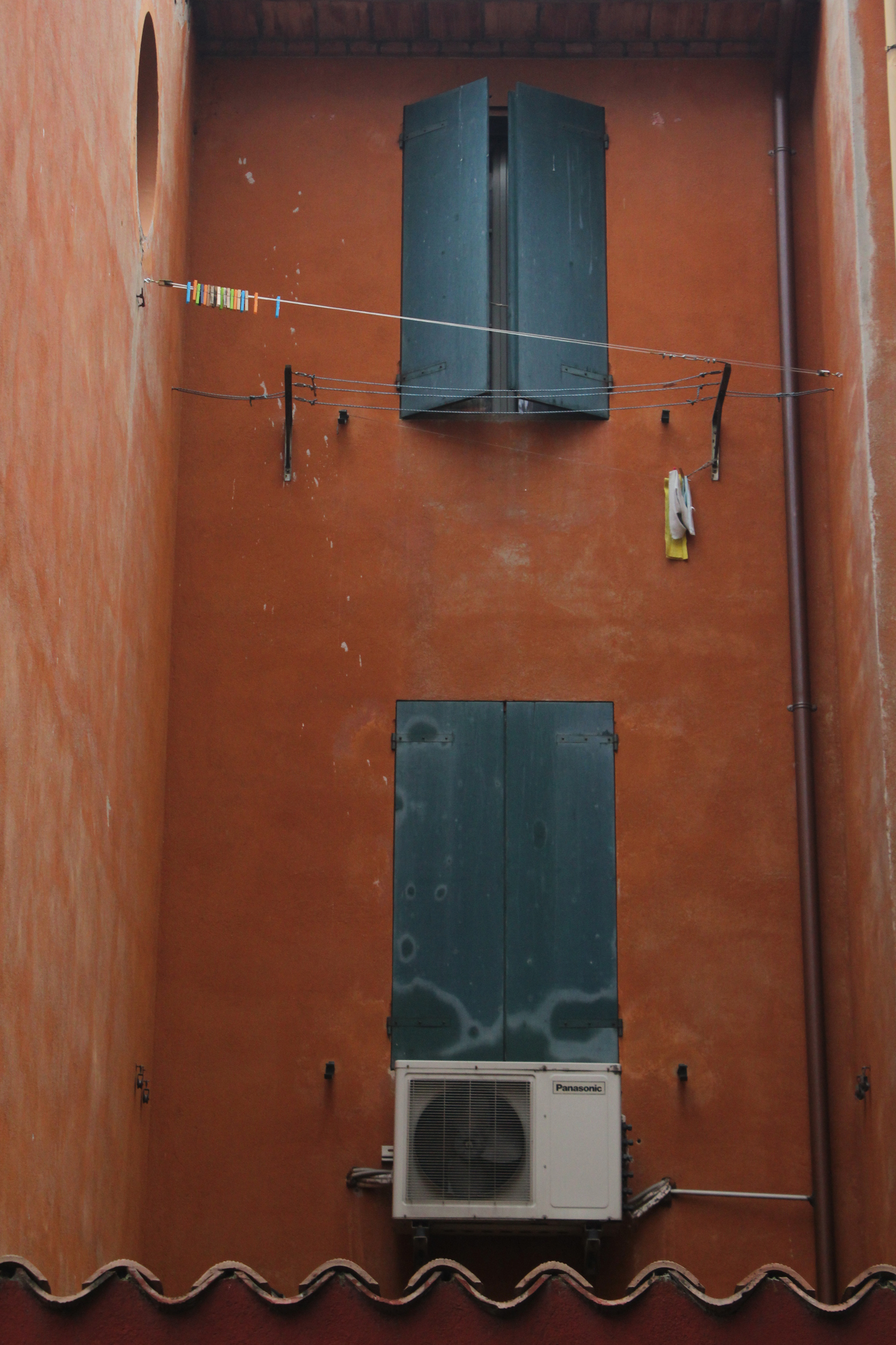 Bologna Italy Red Building Green Window Clothesline