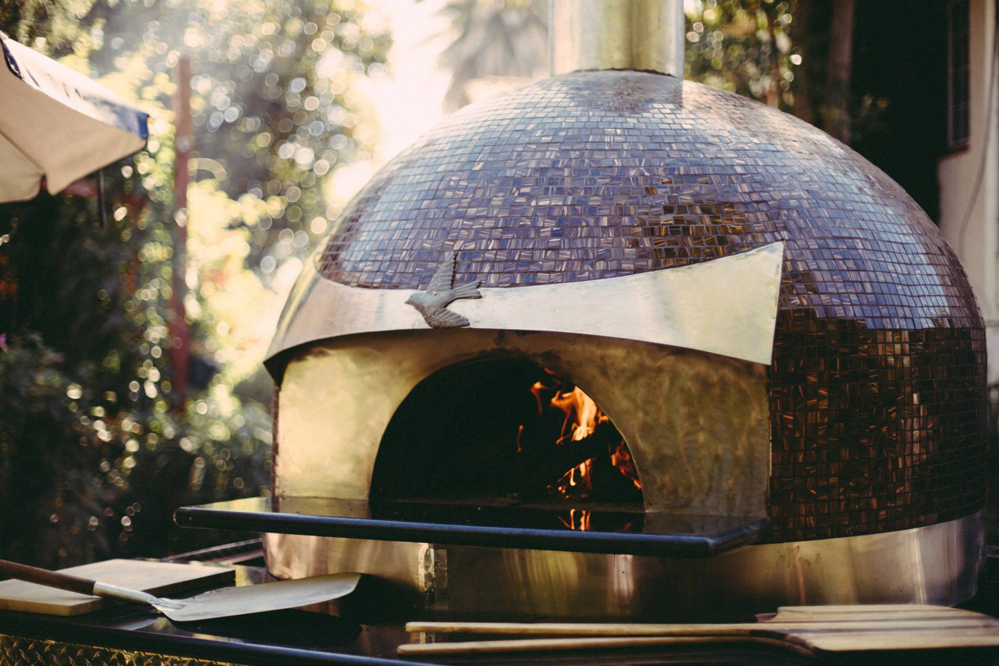 Glass tiled pizza oven made by Forno Piombo in Napa, CA