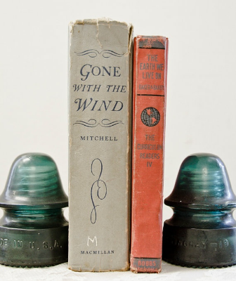 To be honest, this is probably how I would end up using vintage glass insulators. I have tons of books and always in need of cool bookends. Photo courtesy of  Pinterest .