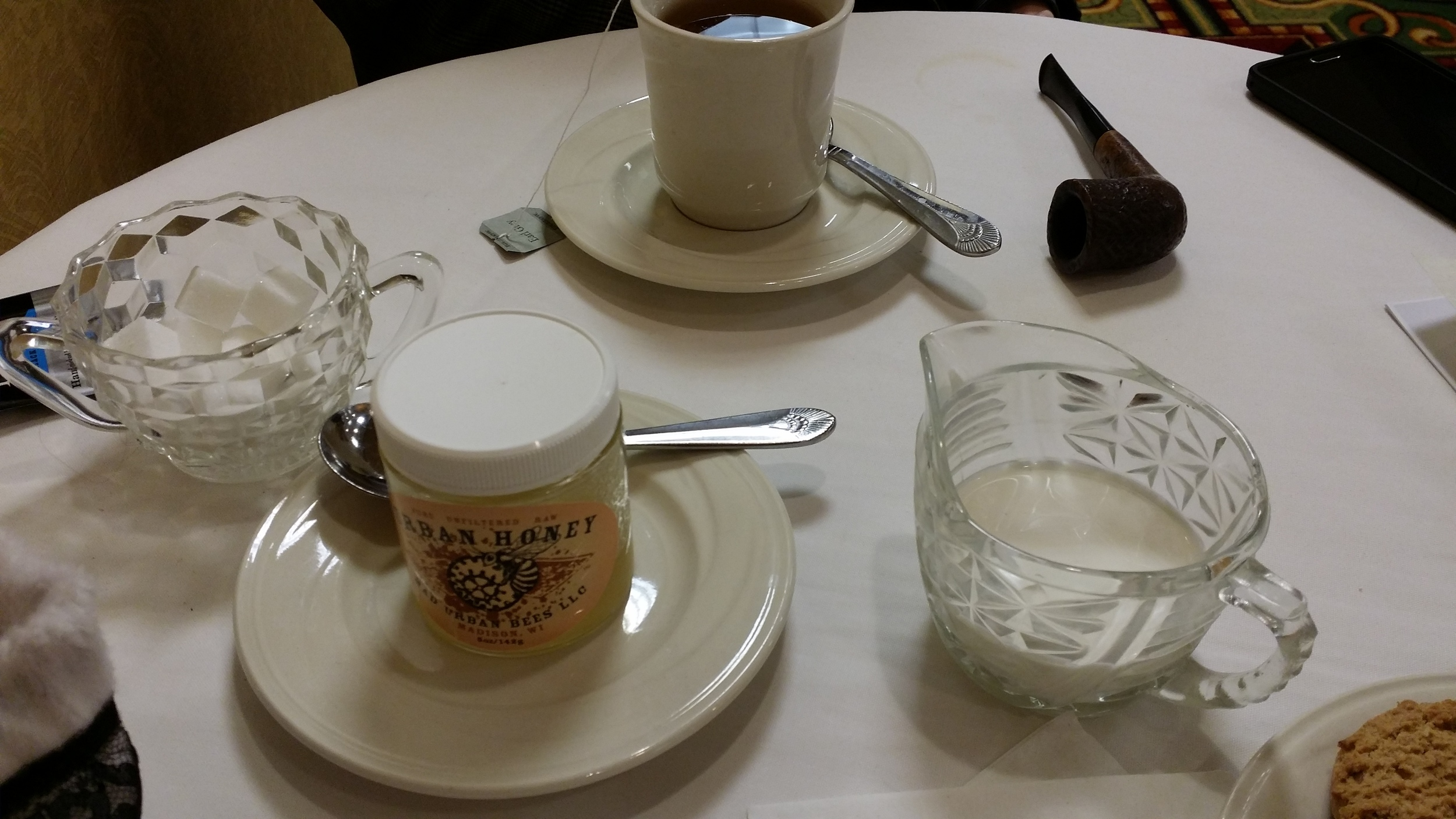 Each table had cream, sugar cubes, and local honey for your tea. (For future reference, I am a splash of cream in my tea kind of girl). Also pipes not includes - we allow props on our tea table.