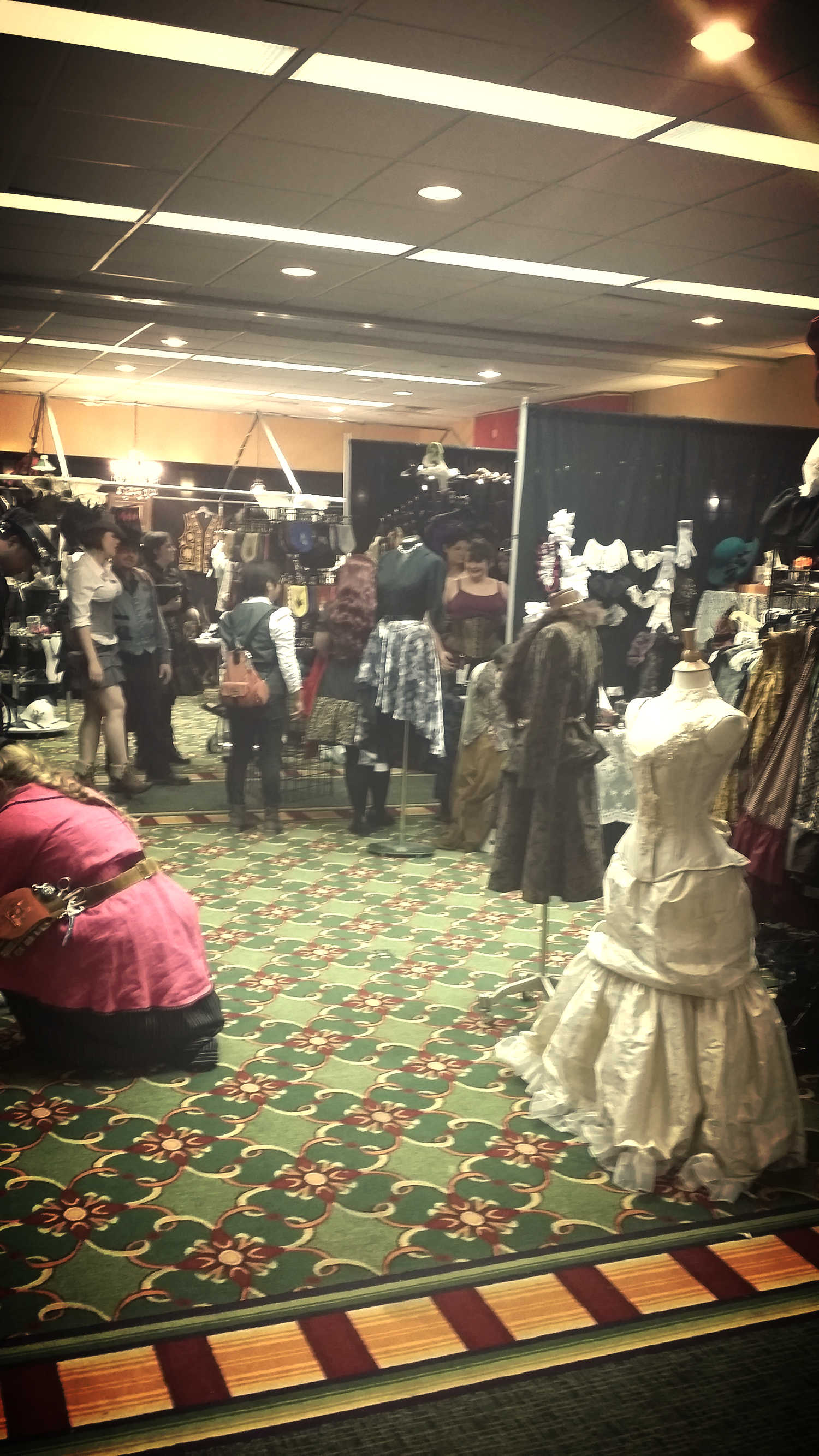A peak inside of the small dealer's room filled with beautiful dresses