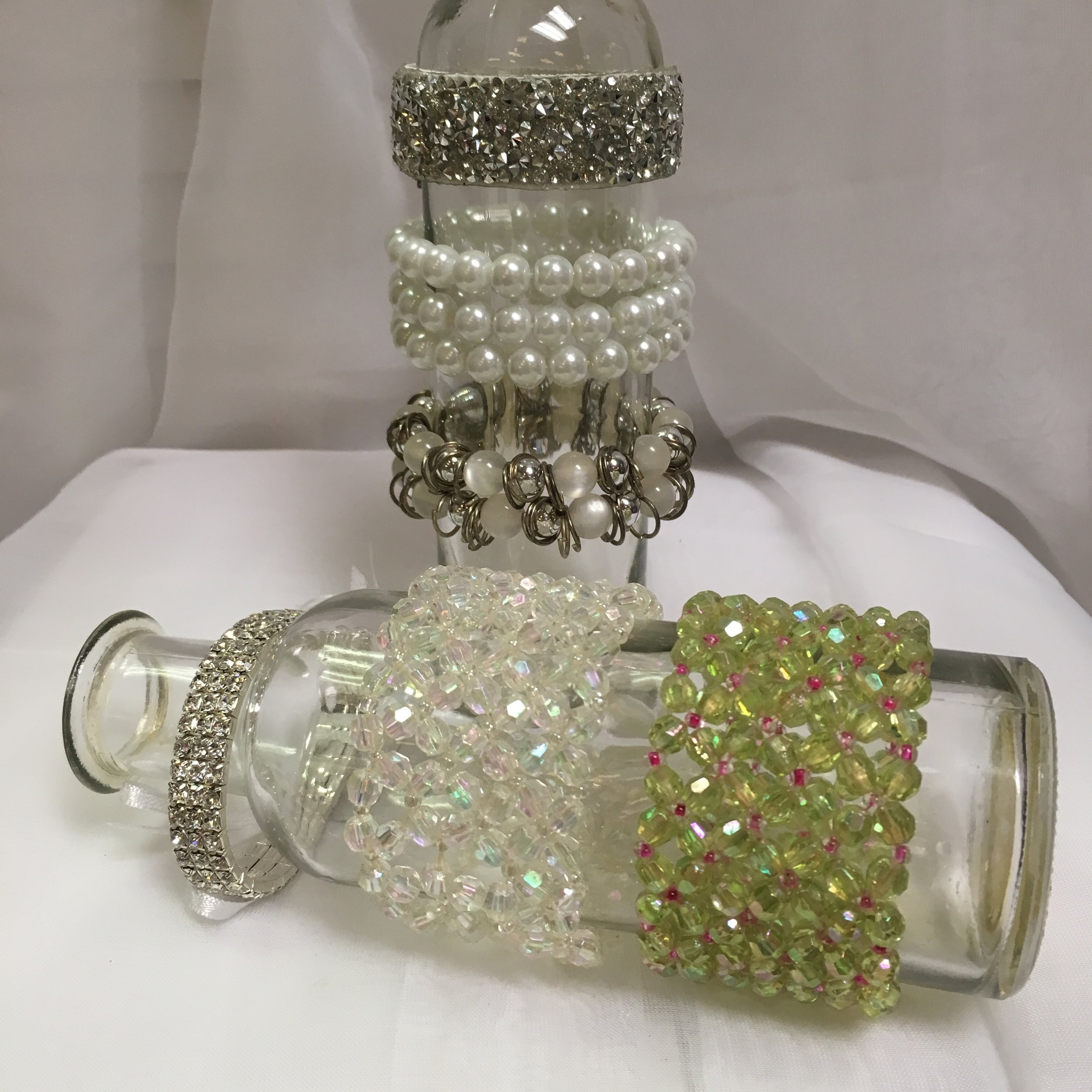 Plus Bracelets: Diamond Road, Pearls, Pearls and Silver Beads; Narrow Rhinestones, Iridescent Beads, Green Beads