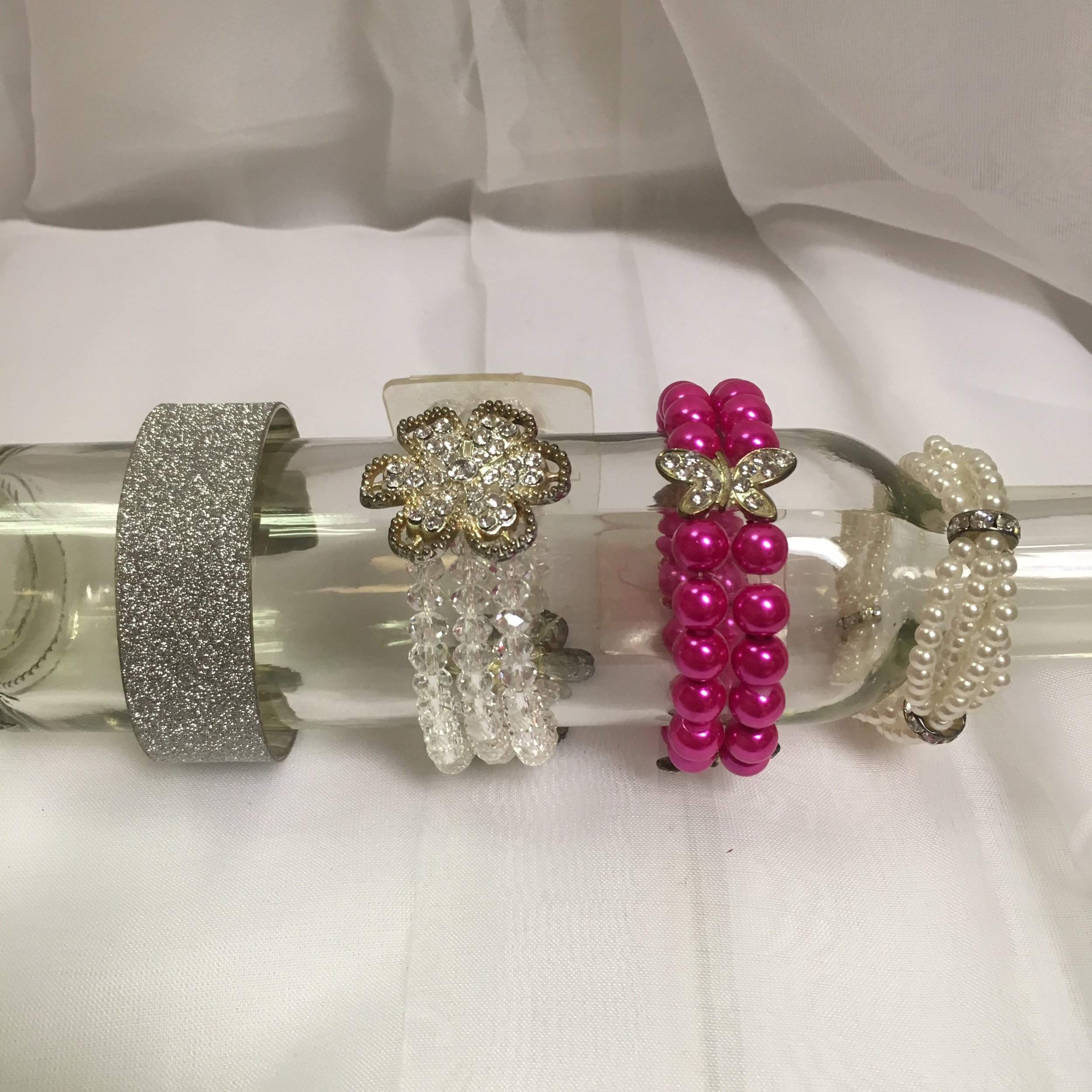 Premium Bracelets: Silver Glitter Cuff, Iridescent Beads and Rhinestones with flower, Hot Pink Beads with butterfly, Pearls and Rhinestones