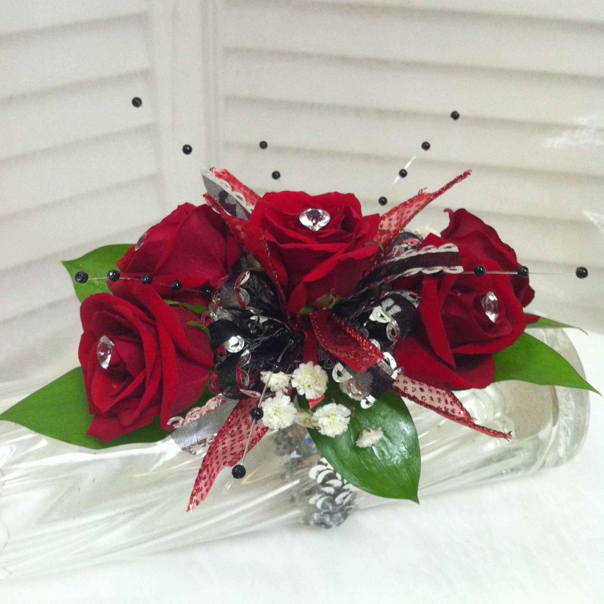 Standard Corsage (25) with Beads (1) and Upgraded Bow (2) $28