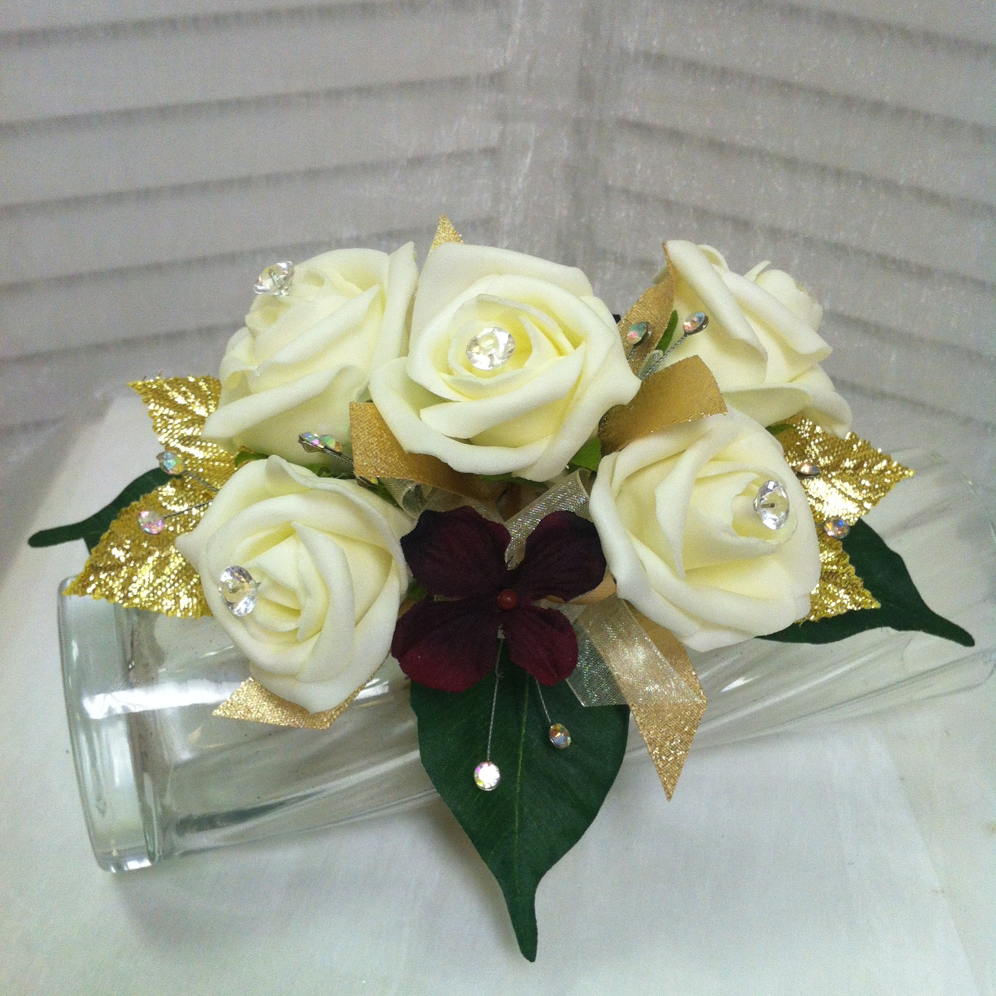 Plus Corsage (30) with Sparkly Leaves (2) $32