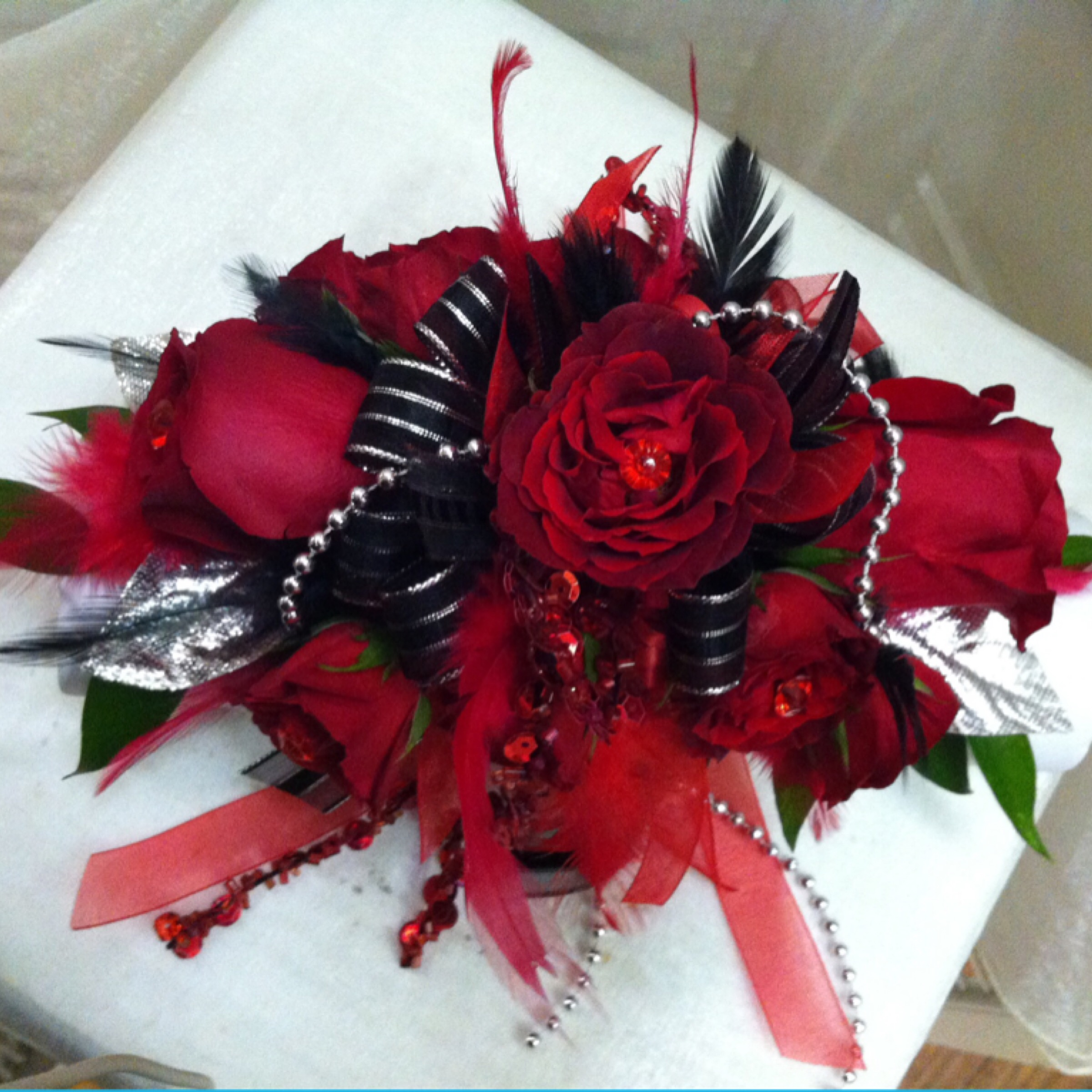 Deluxe Corsage (45) with Sparkly Leaves (2) and Extra Flowers (5) $52