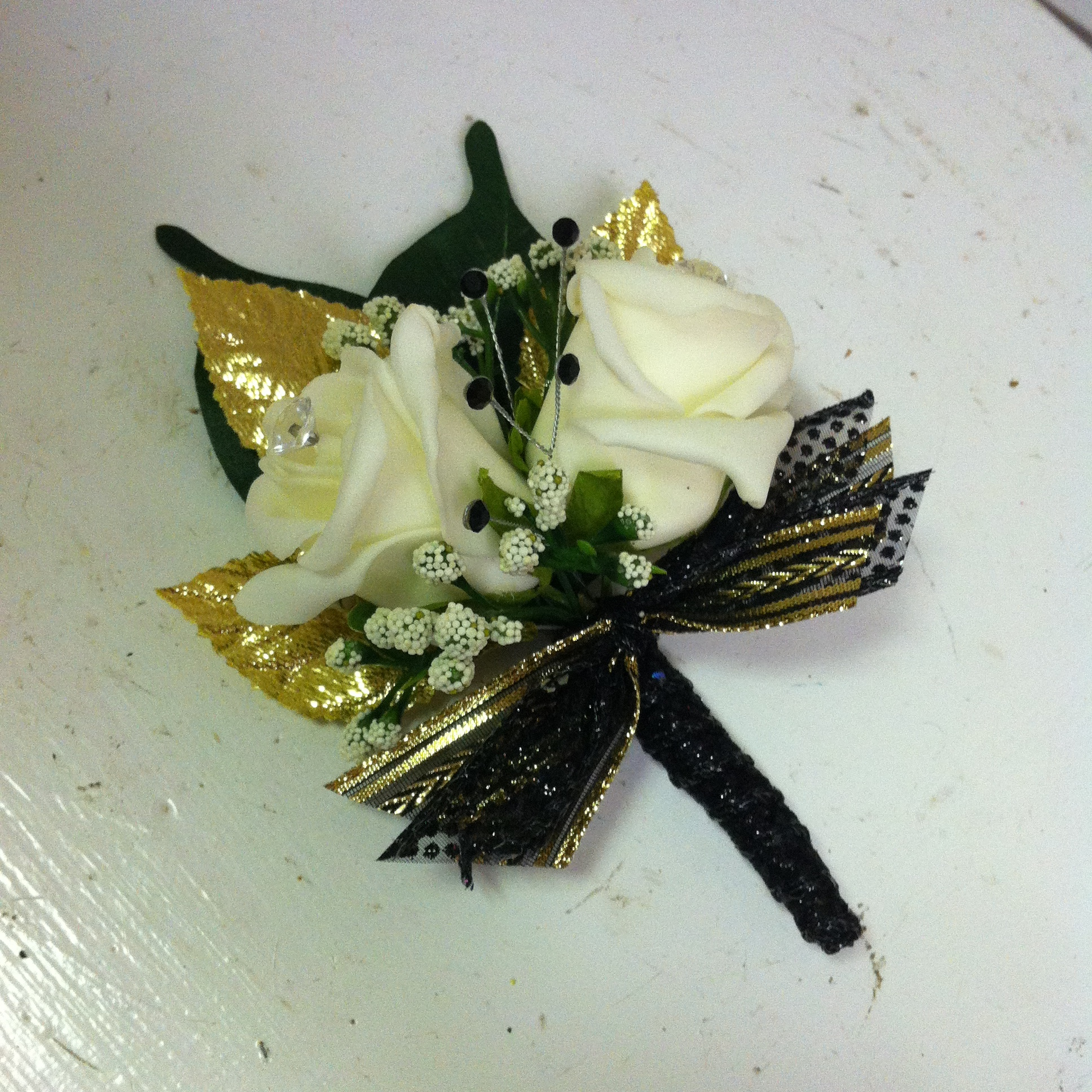 Plus Boutonniere (12) with Sparkly Leaves (2) $14