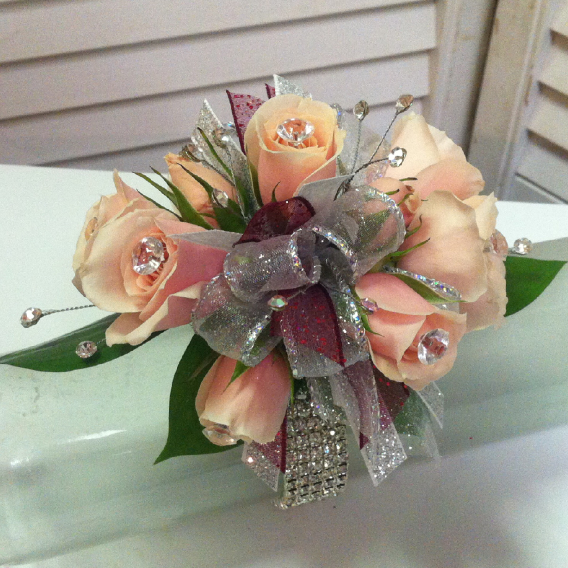Plus Corsage (30) with Extra Flowers (5), Extra Jewels (5), Upgraded Bow (2), Deluxe Bracelet (7) $49