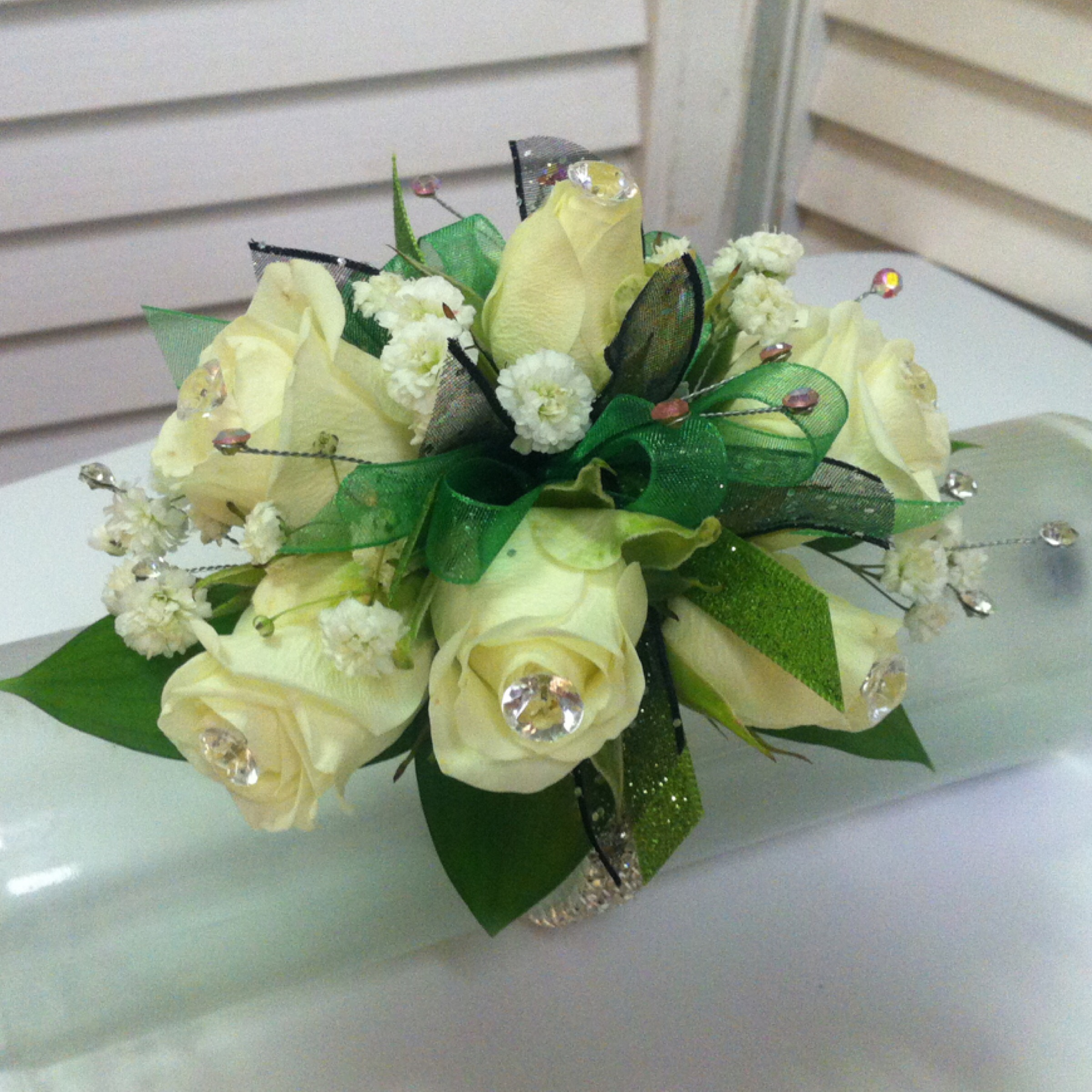 Plus Corsage (30) with Extra Flowers (5) and Extra Jewels (5) $40