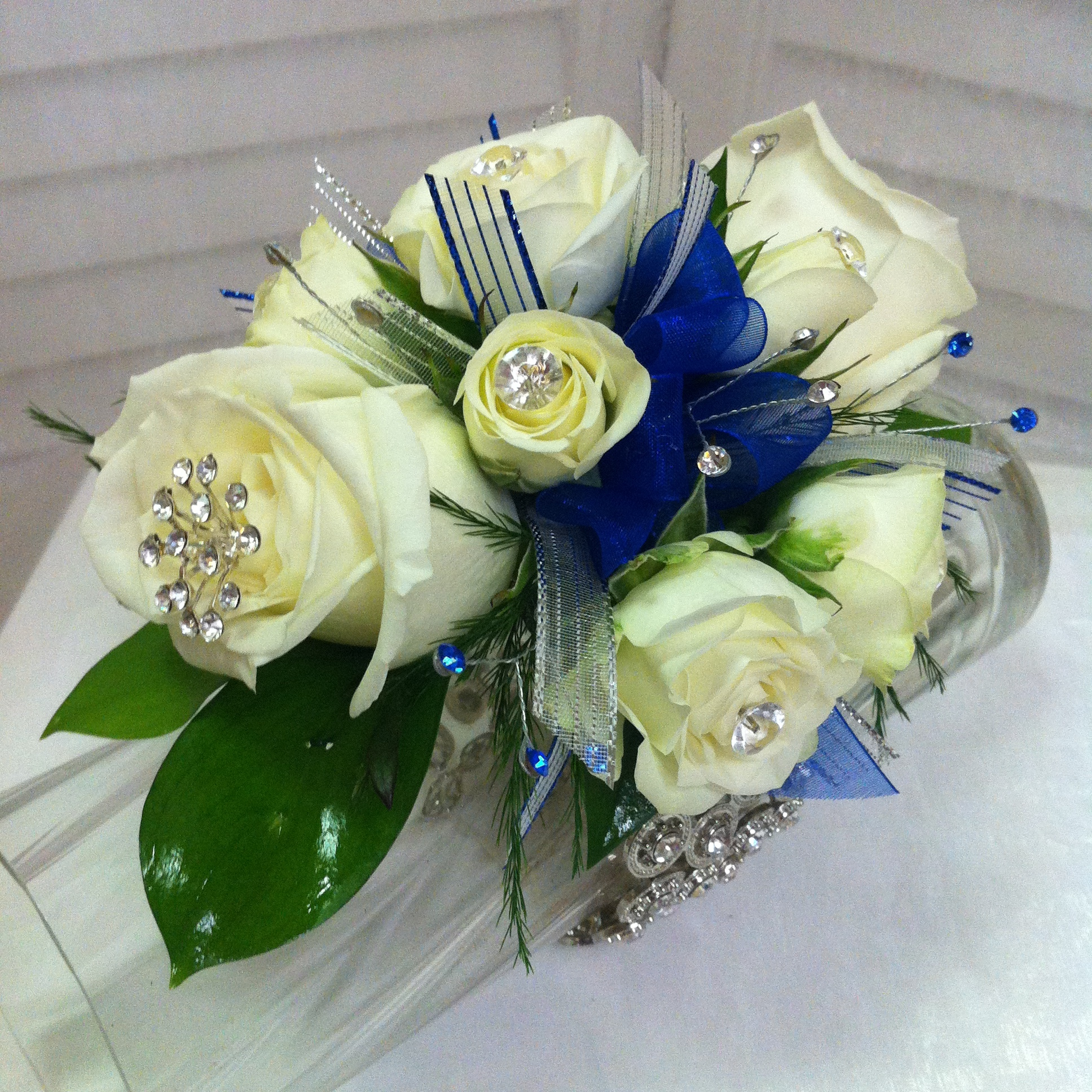 Plus Corsage (30) with Extra Flowers (5), Extra Jewels (5), Super Bracelet (12), Specialty Jewels (8) $60