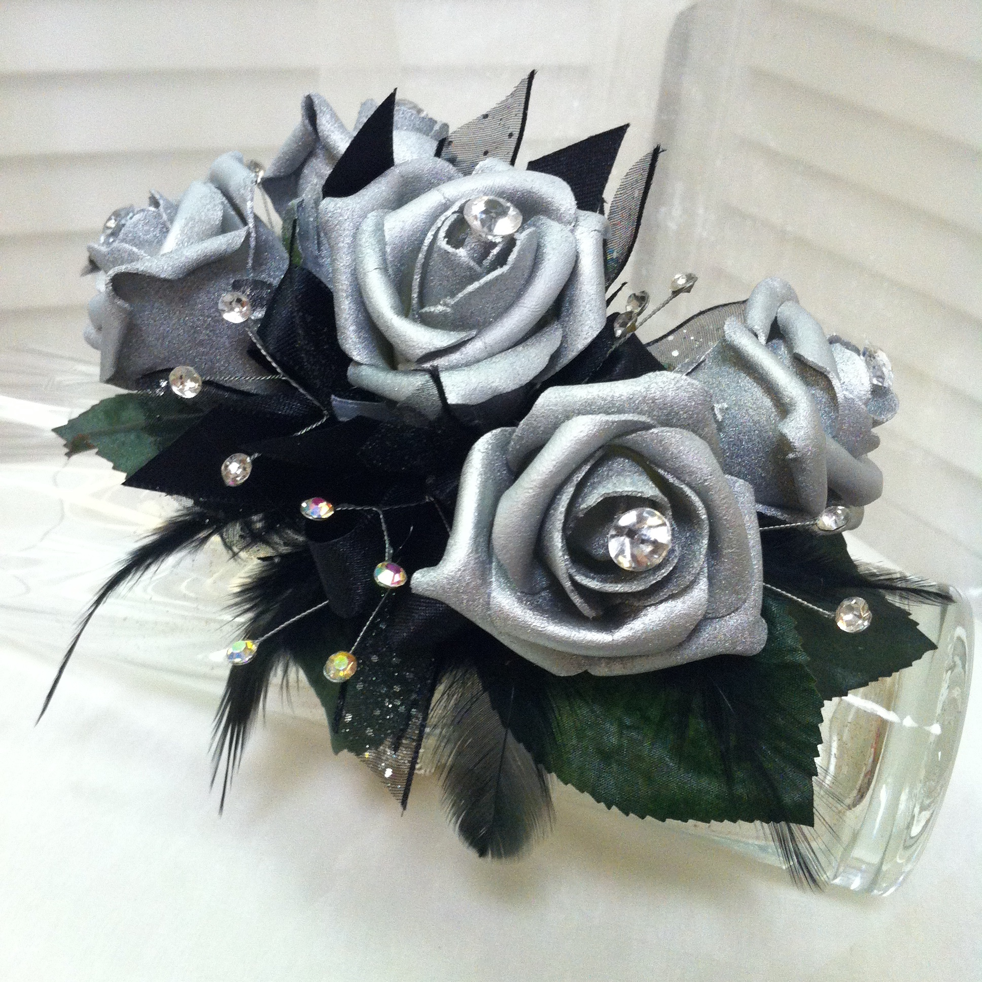 Premium Corsage (35) with Extra Jewels (5), Deluxe Bracelet (3), Standard Bow (-2), Specialty Flowers (3) $44