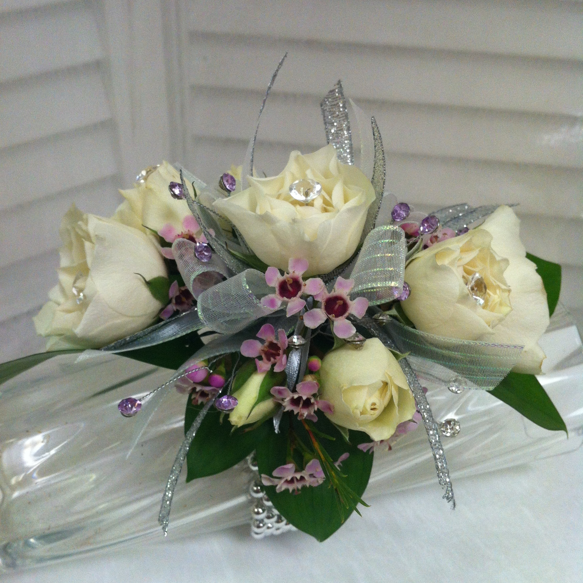 Plus Corsage (30) with Extra Jewels (5), Extra Flowers (5), Upgraded Bow (2) $42