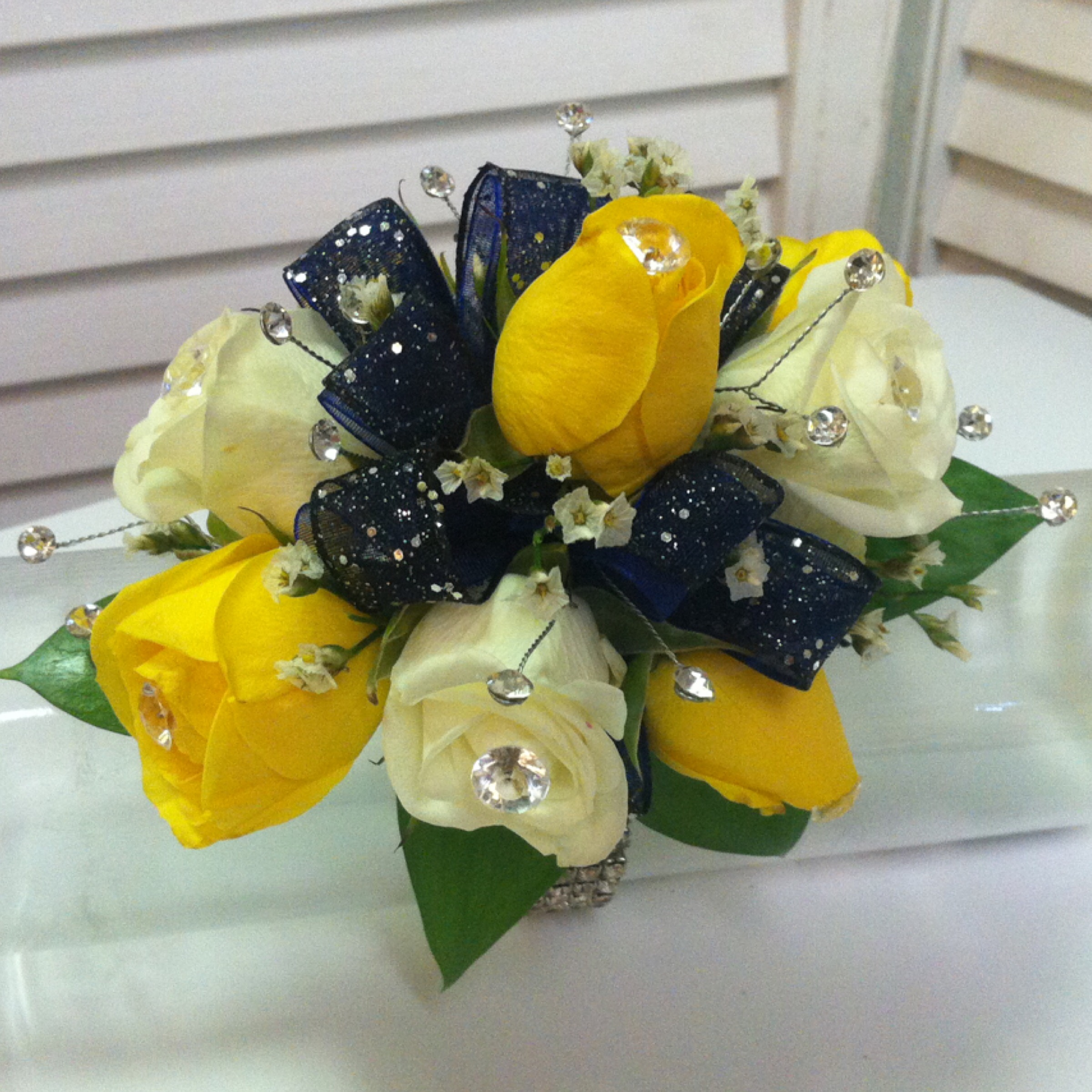Plus Corsage (30) with Extra Jewels (5), Extra Flowers (5), Deluxe Bracelet (7) $47