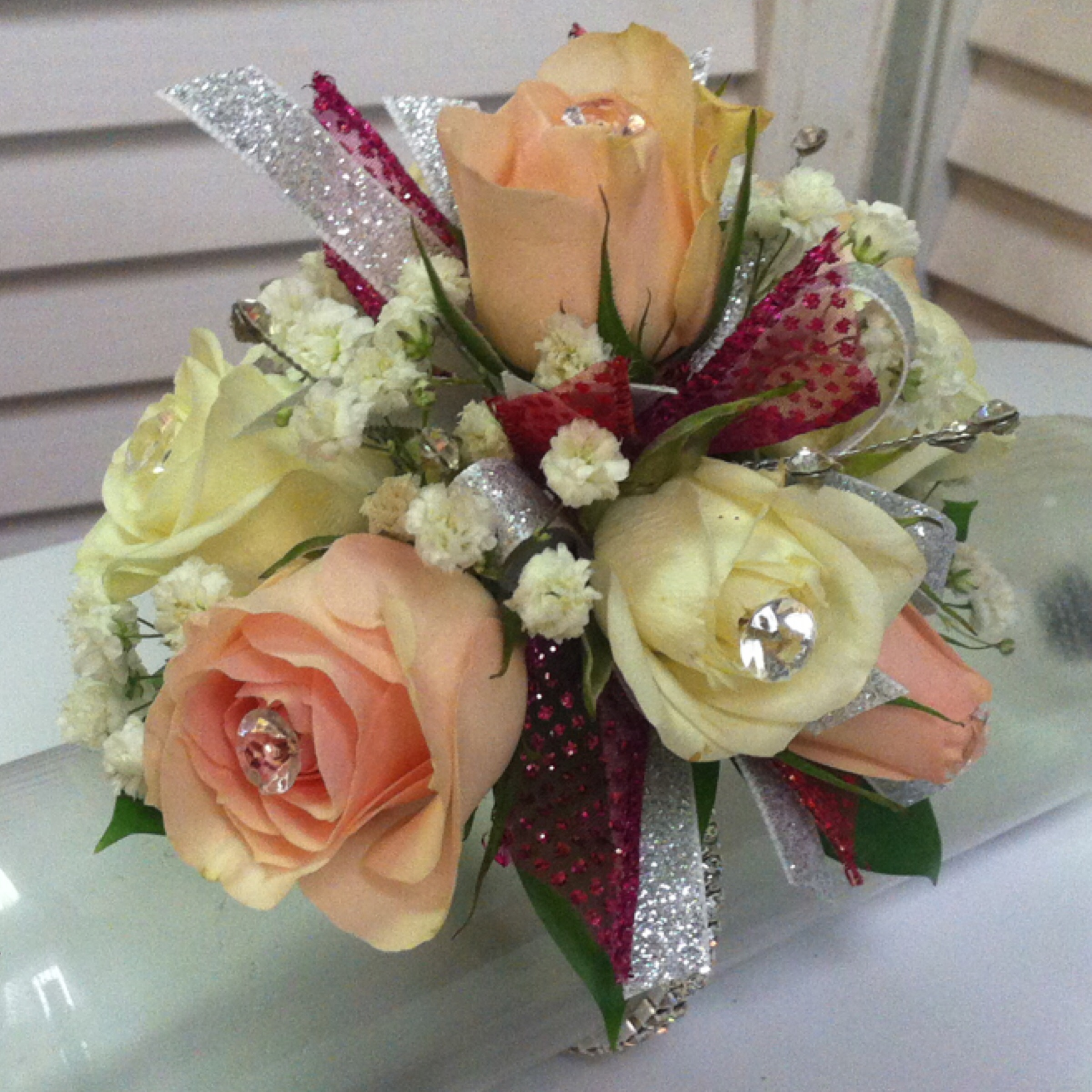 Plus Corsage (30) with Upgraded Bow (2) and Extra Flowers (5) $37