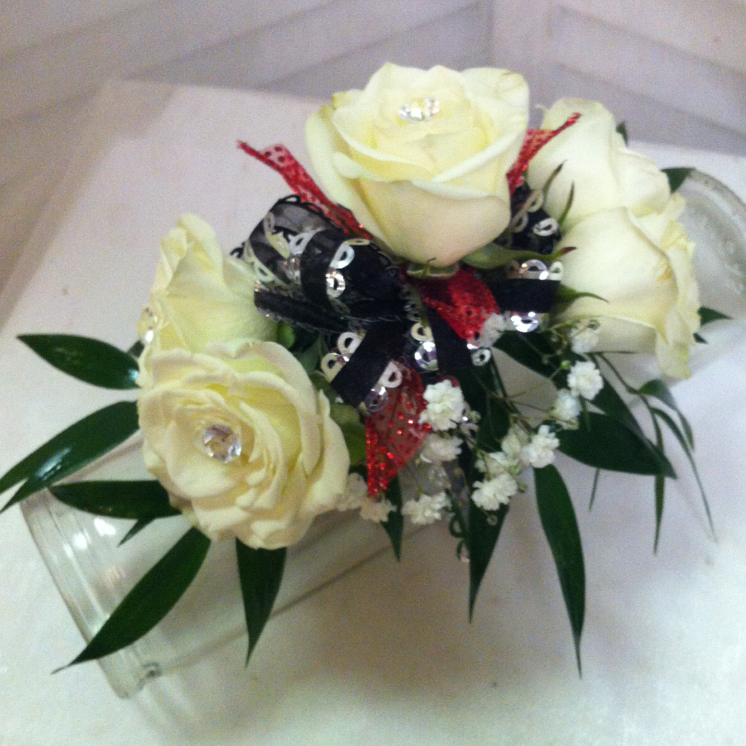 Standard Corsage (25) with Upgraded Bow (2) $27