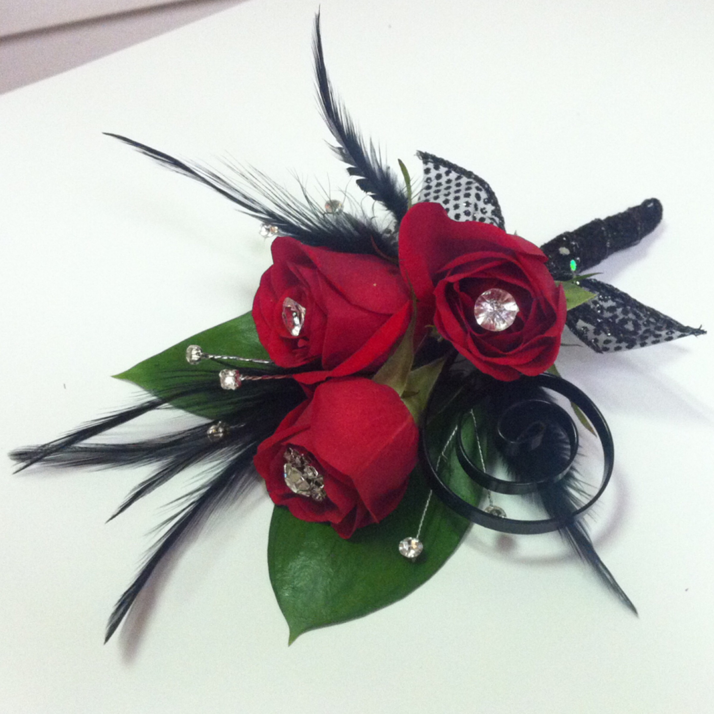 Premium Boutonniere (14) with Extra Jewels and Feathers and Specialty Embellishments (6) $20