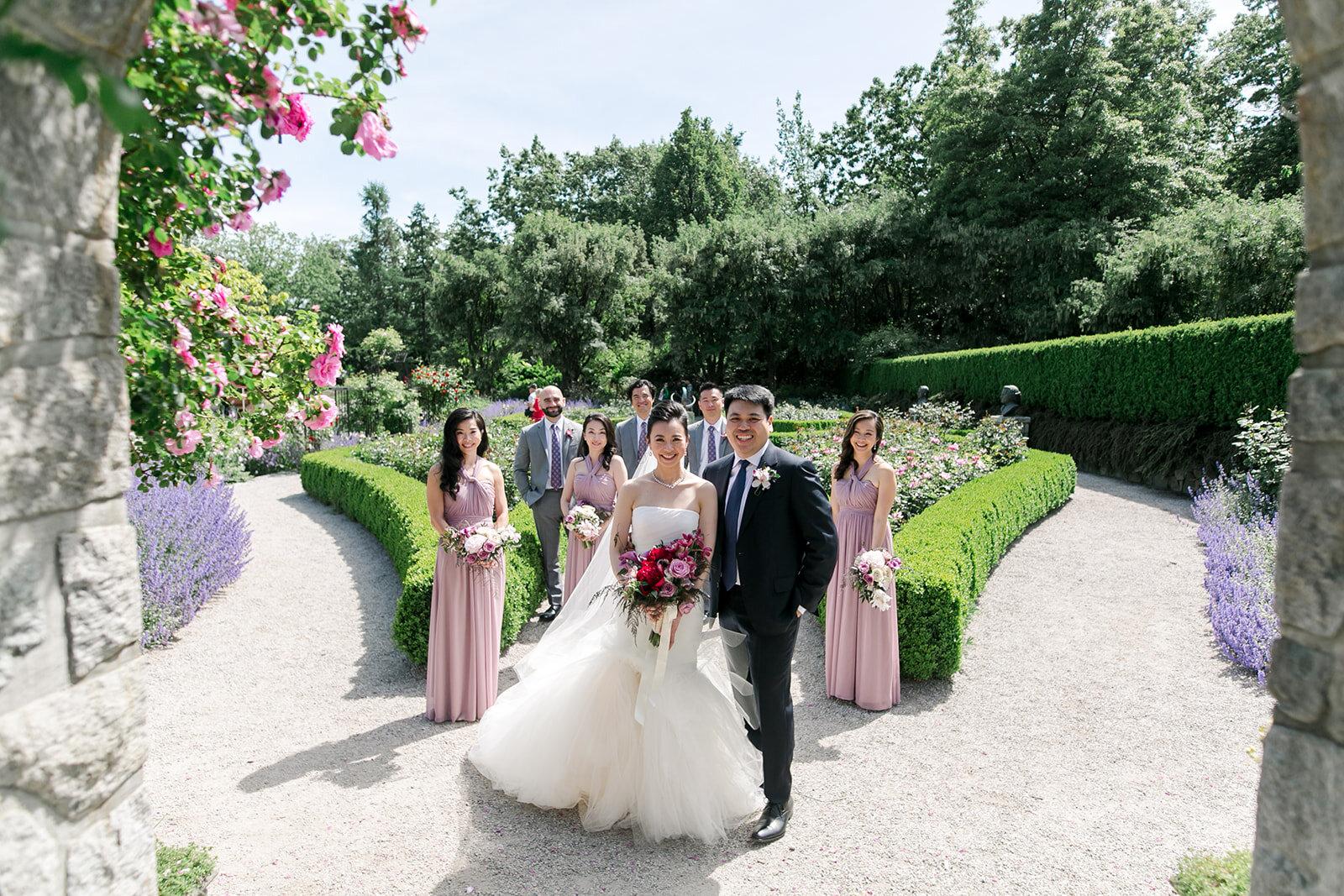 Jessica & Alex JW Marriott Parq Wedding. Wedding Party photos at Vandusen Gardens. Beautiful manicured garden and the bridesmaids in mauve purple matching dresses   Keepsake Events