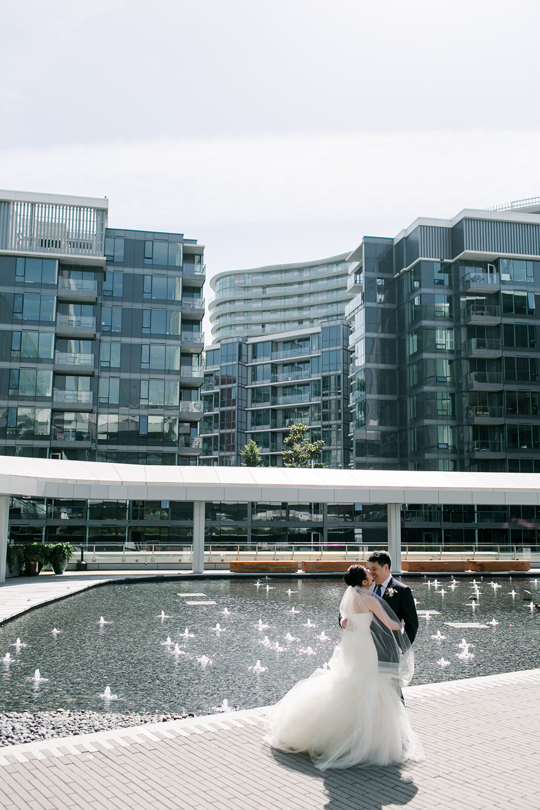 Jessica & Alex JW Marriott Parq Hotel Wedding in Vancouver. Bride and Groom portraits outside. Vera Wang wedding gown, Hugo Boss suit for the Groom   Keepsake Events