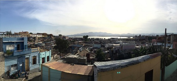 After an early morning, somewhat difficult bus ride to Santiago we found our Casa Particular, slept and then hit the street just in time for this beautiful view.