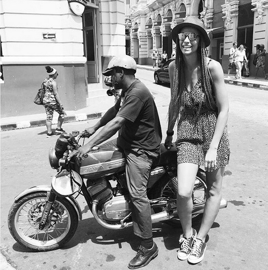 Santiago de Cuba is known for their motorcycle taxis. It's the easiest way to get around and they are all over the city. I'm pretty sure this driver would rather have been picking someone up than taking a picture with me but I will take it! :-)