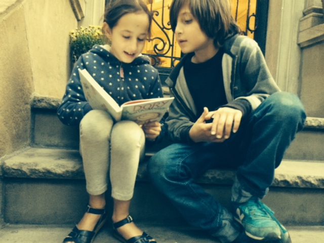 My daughter reading the book to her buddy on her grandmother's stoop the day we got our copy.