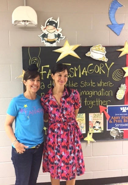 "WIth the extraordinary Bonnie Lang, librarian at Doss Elementary. Please notice SHE IS WEARING A MRS. GOBBLE GRACKER BUN!  And a homemade ""Fantasmagory"" t-shirt."
