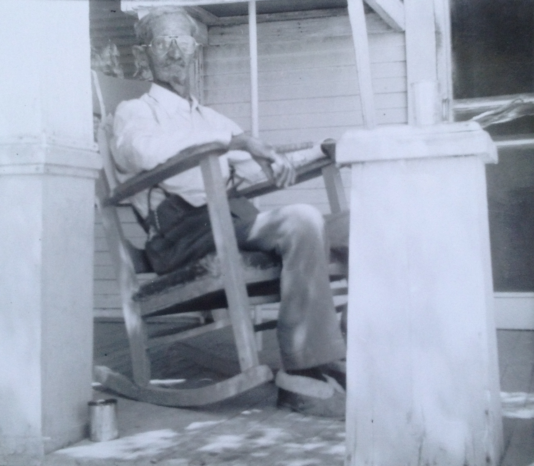"""Charles Colwell. 1956. Pecos, Texas  Yep, that's what they call a """"Chew Can"""" next to the porch pillar."""