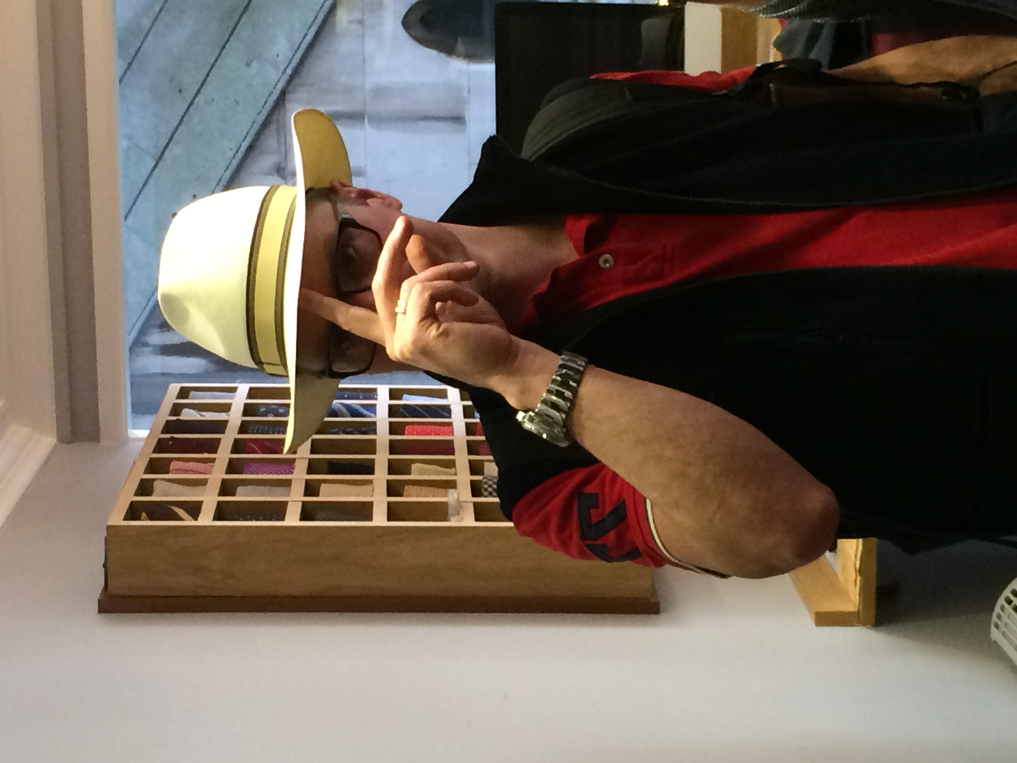 The City Milliner client trying on his bespoke panama