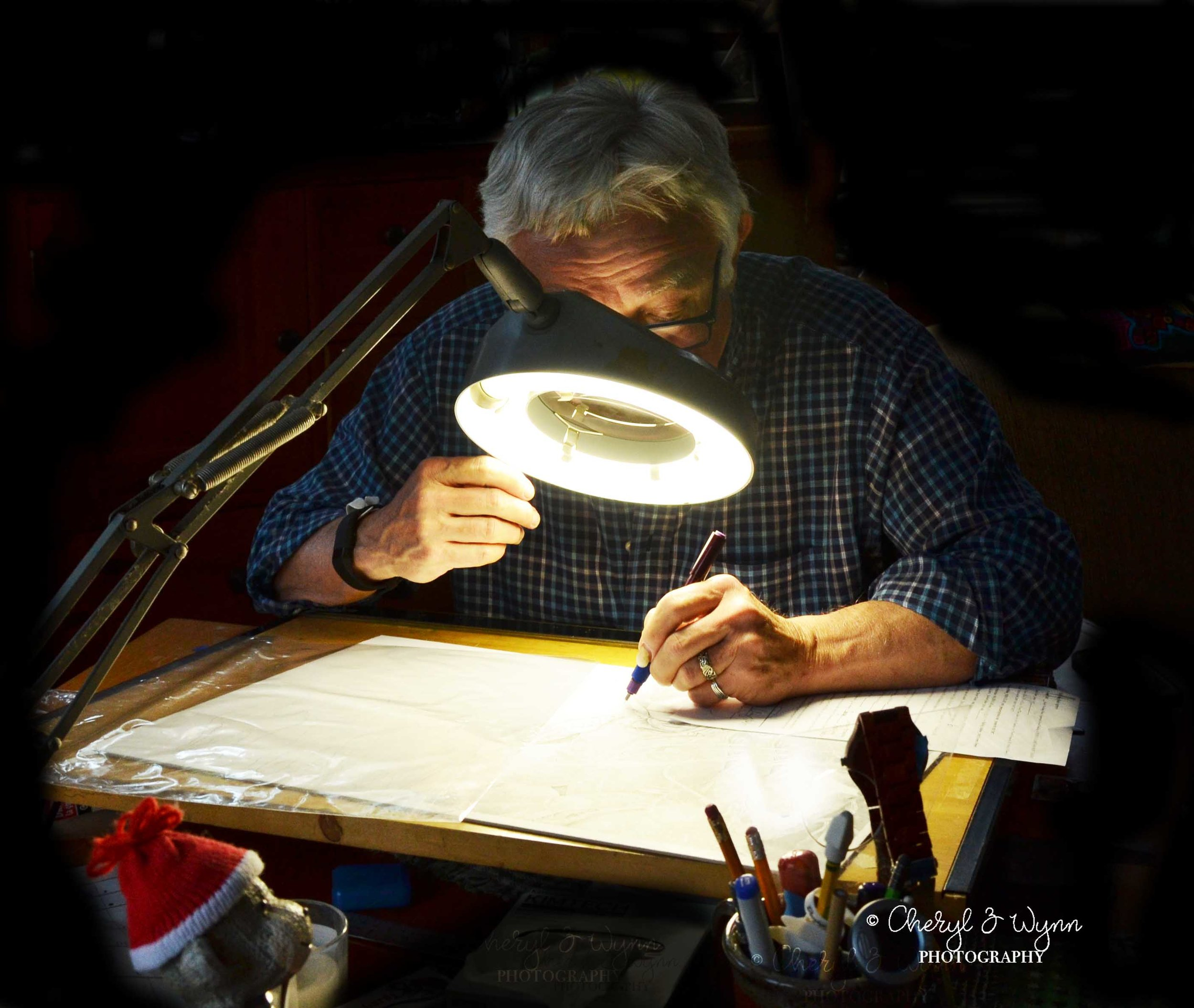 Henry at work at his drawing table ~ creating master pieces using a technical fountain pen, a magnifying glass.
