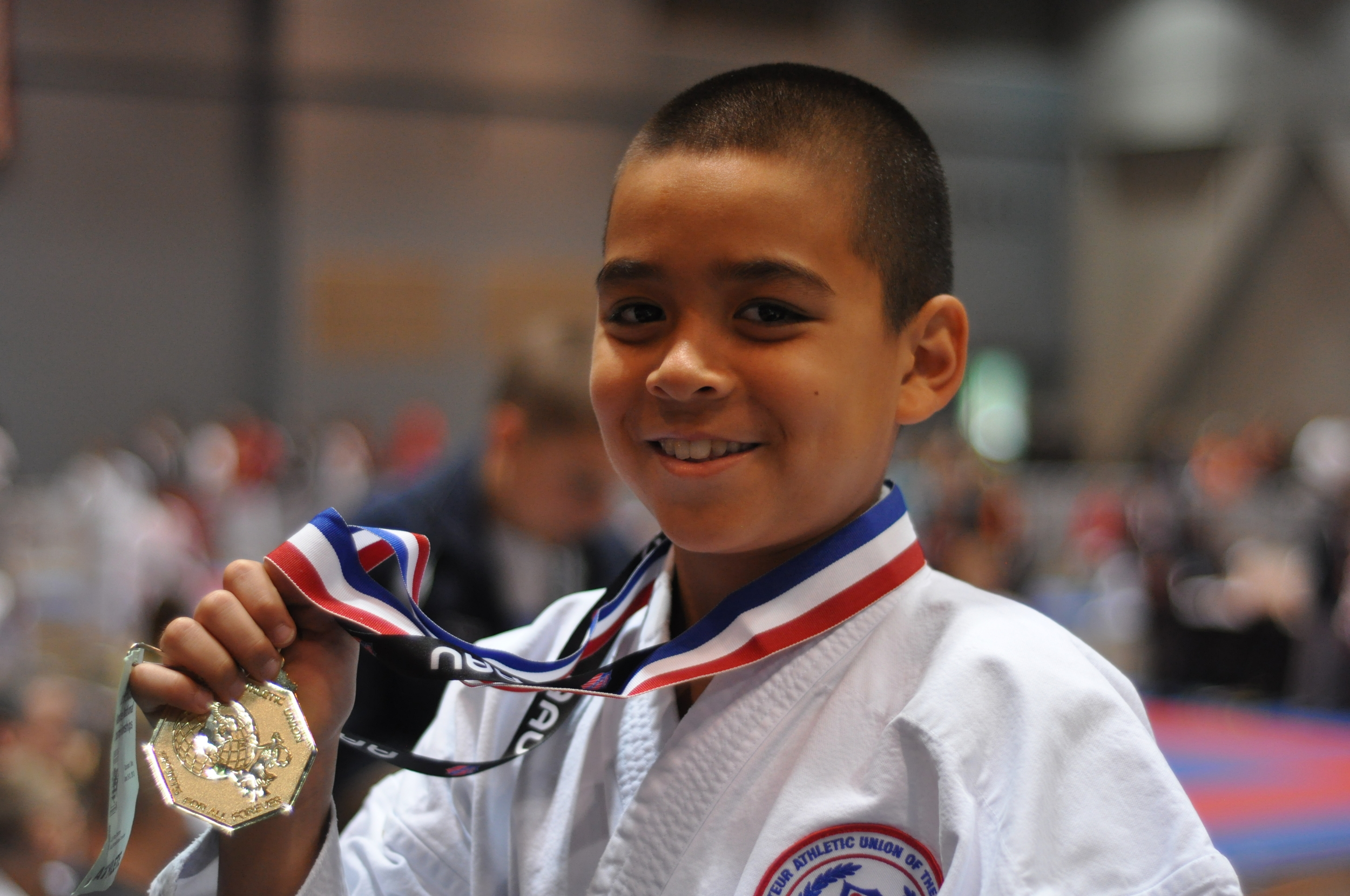 JJ with gold medal.jpg