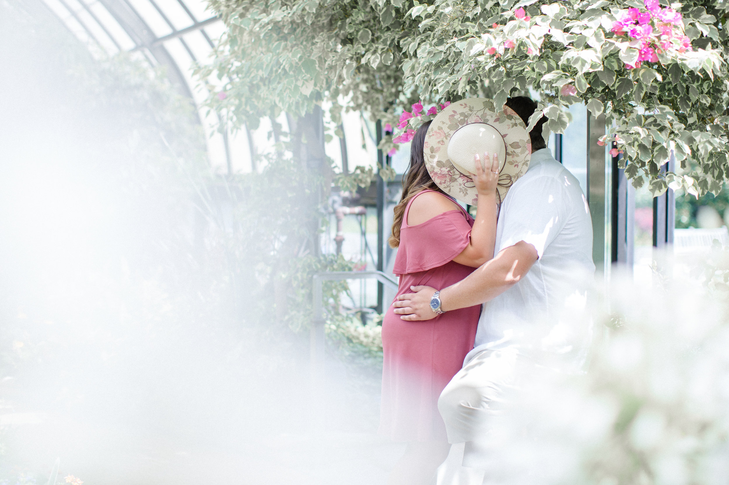 Couple at Longwood Gardens under bougainvillea