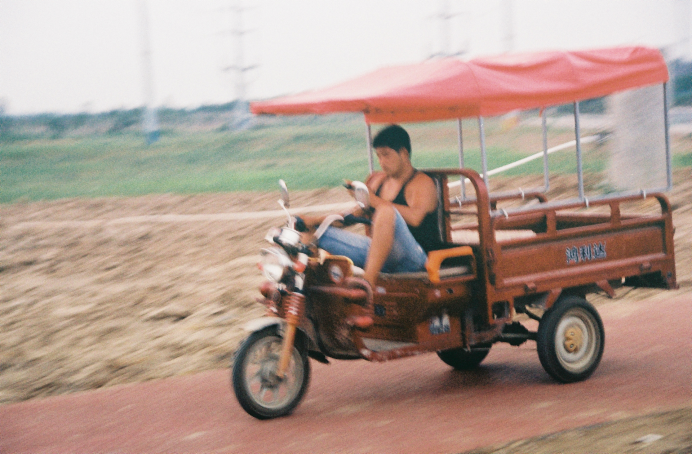 countryside outside of xi'an. man hustling.