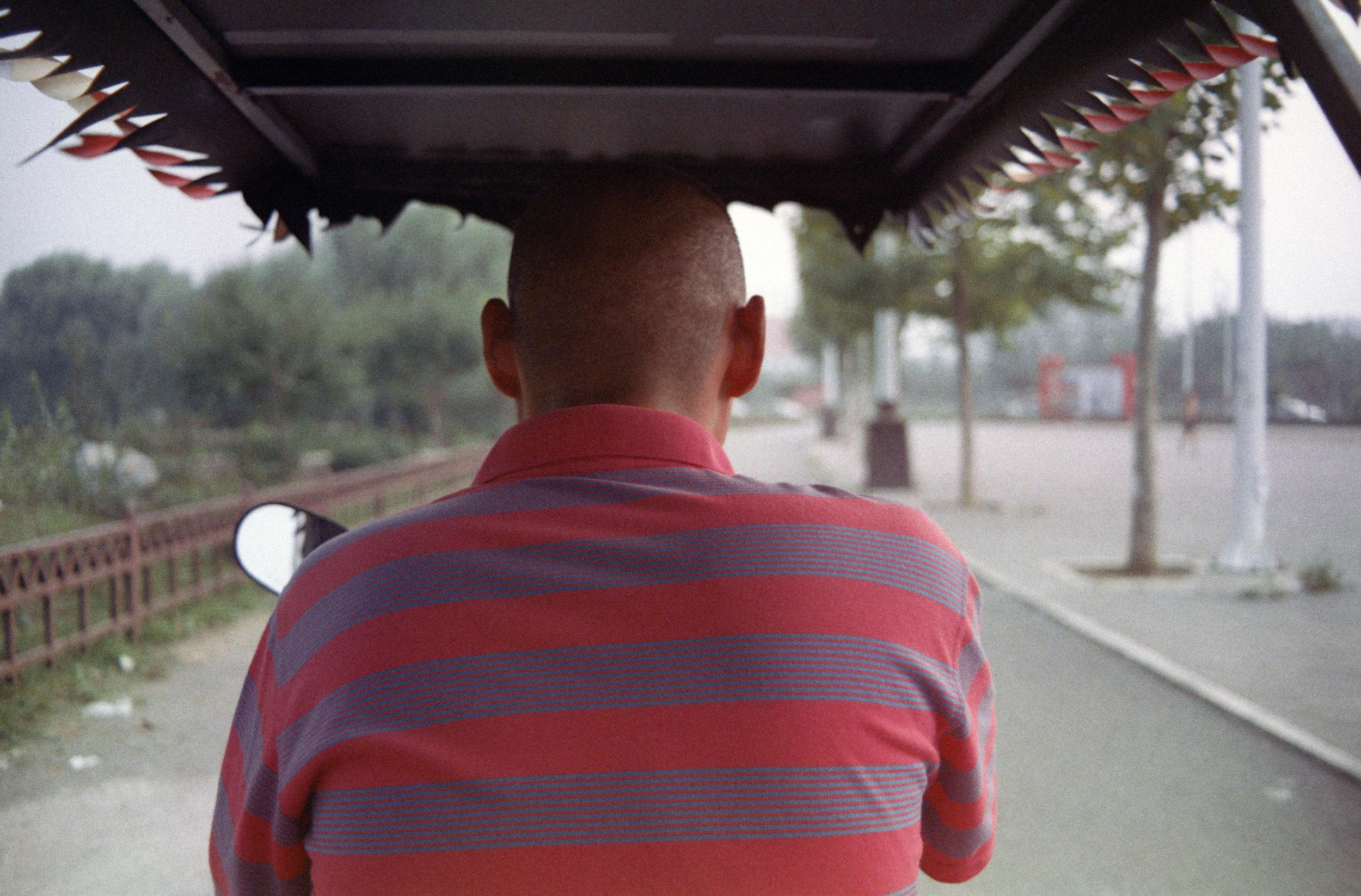 trusting the man on a three-wheel vehicle, beijing, 2015.