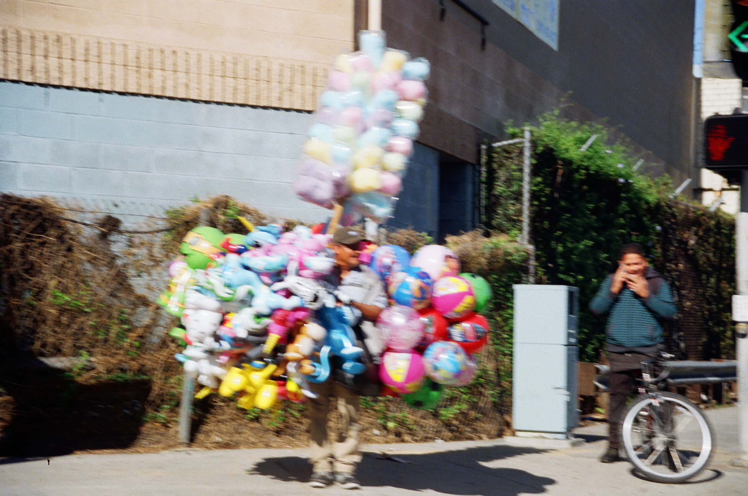 many of them sell balloons next to the entrance of freeways. they stand in the same spot for hours as cars drive by but never stop. los angeles, 2017
