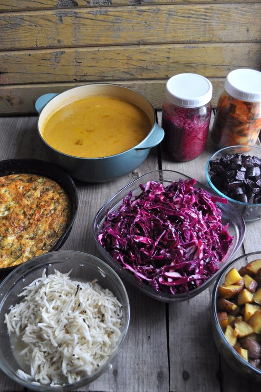 Clockwise from top : Carrot bisque with coriander, purple sauerkraut, kimchi, roasted beets, purple coleslaw, roasted potatoes, turnip + black radish slaw, frittata with potatoes + ham.