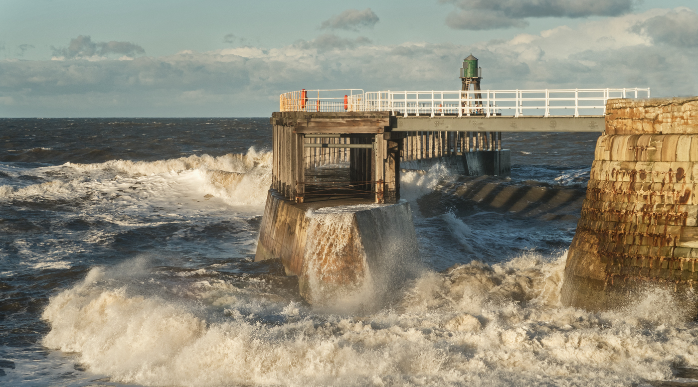 Water surging through the West Pier