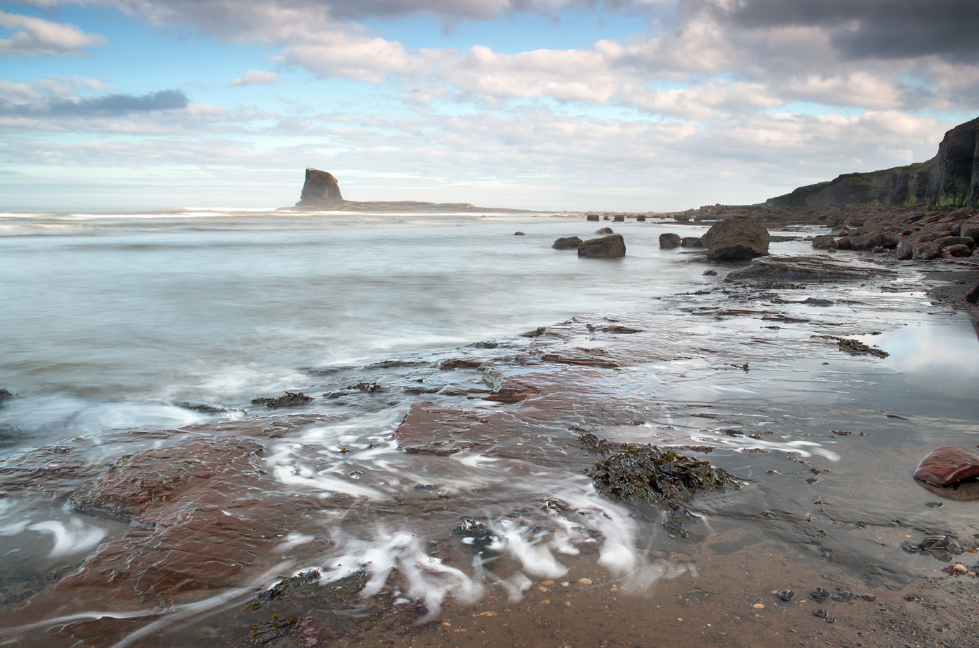 Black Nab: tide clearing from the cliff edge