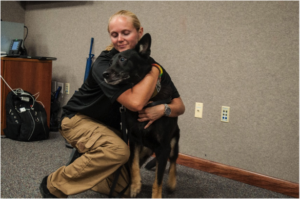 MacDill AFB officer with her K-9 partner