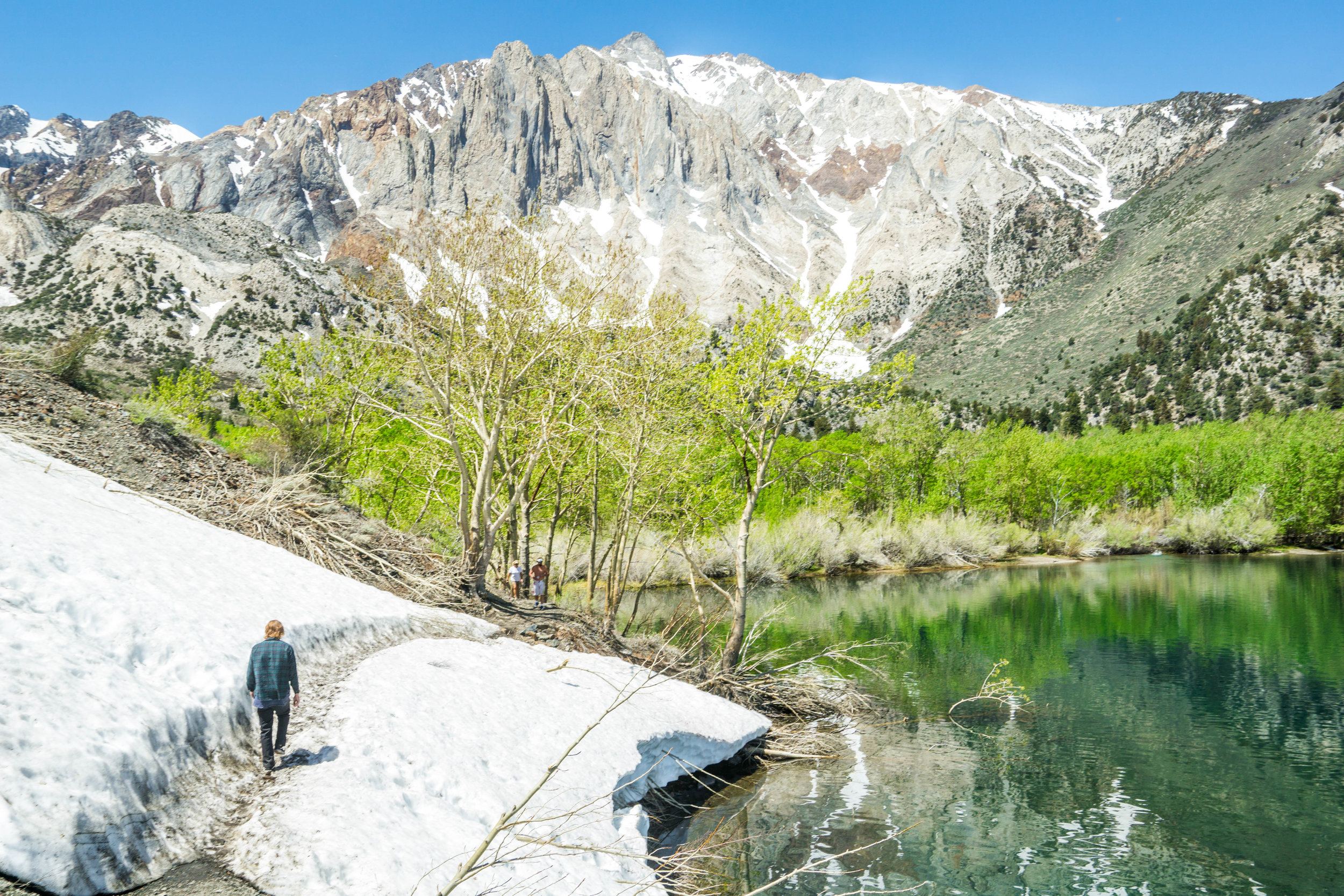 Even in late Spring & early Summer, there is frequently snow on the trail in the Sierra Nevadas. Walking without traction, we methodically crossed to assure we didn't slip & slide into the lake.