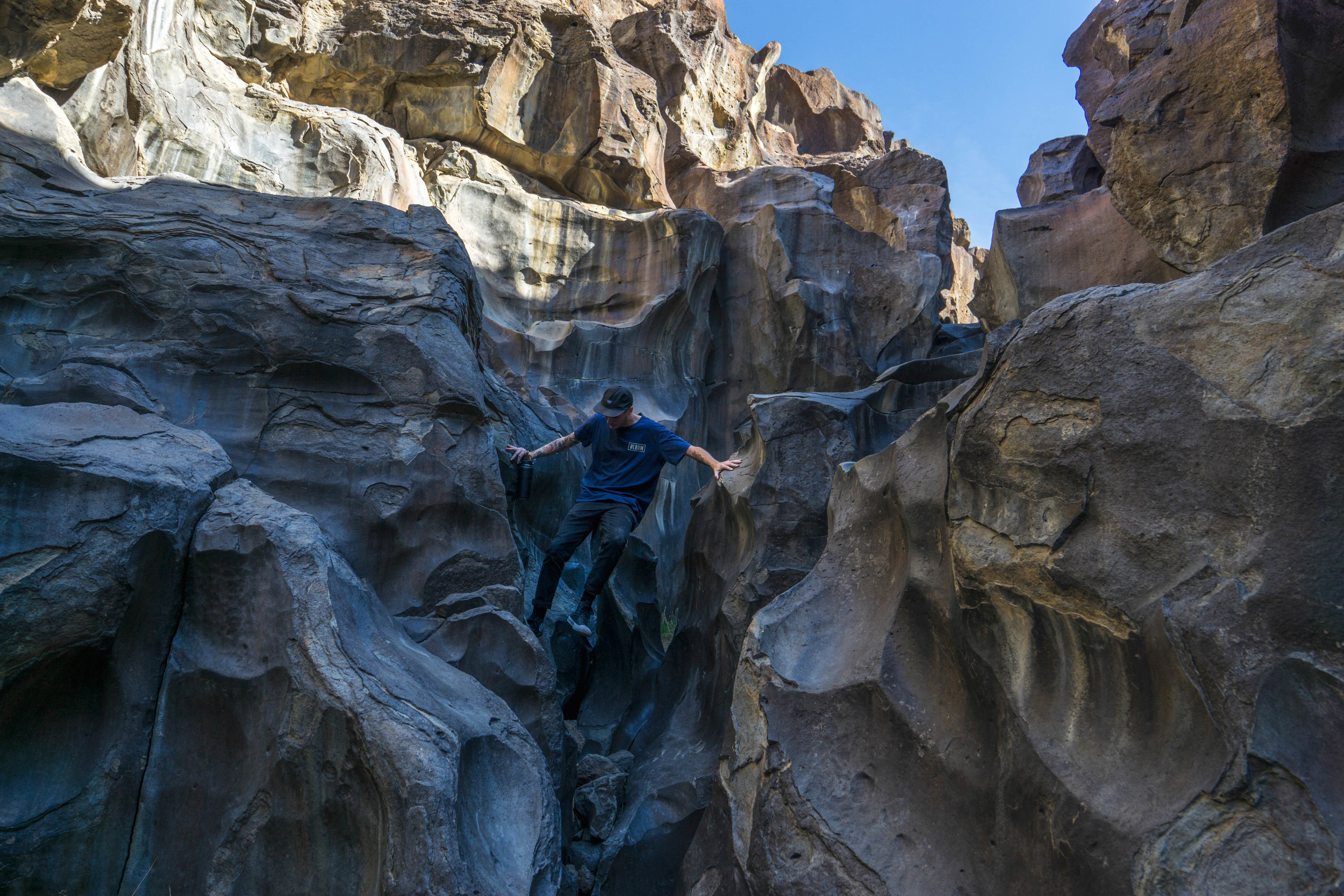 Unable to resist the temptation, we climb down into the water-slick lava rock canyon.