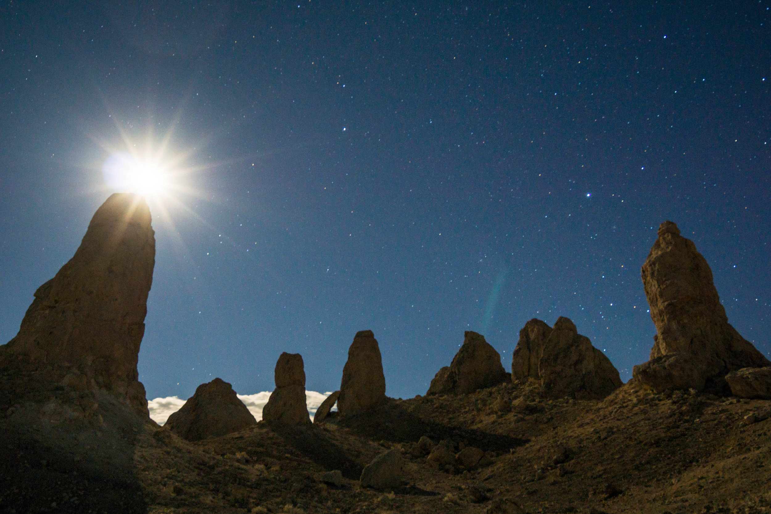 After struggling to set up camp in an unrelenting wind, we embark on a hike under the moonlight through an array of pinnacles formed beneath an ancient inland sea.