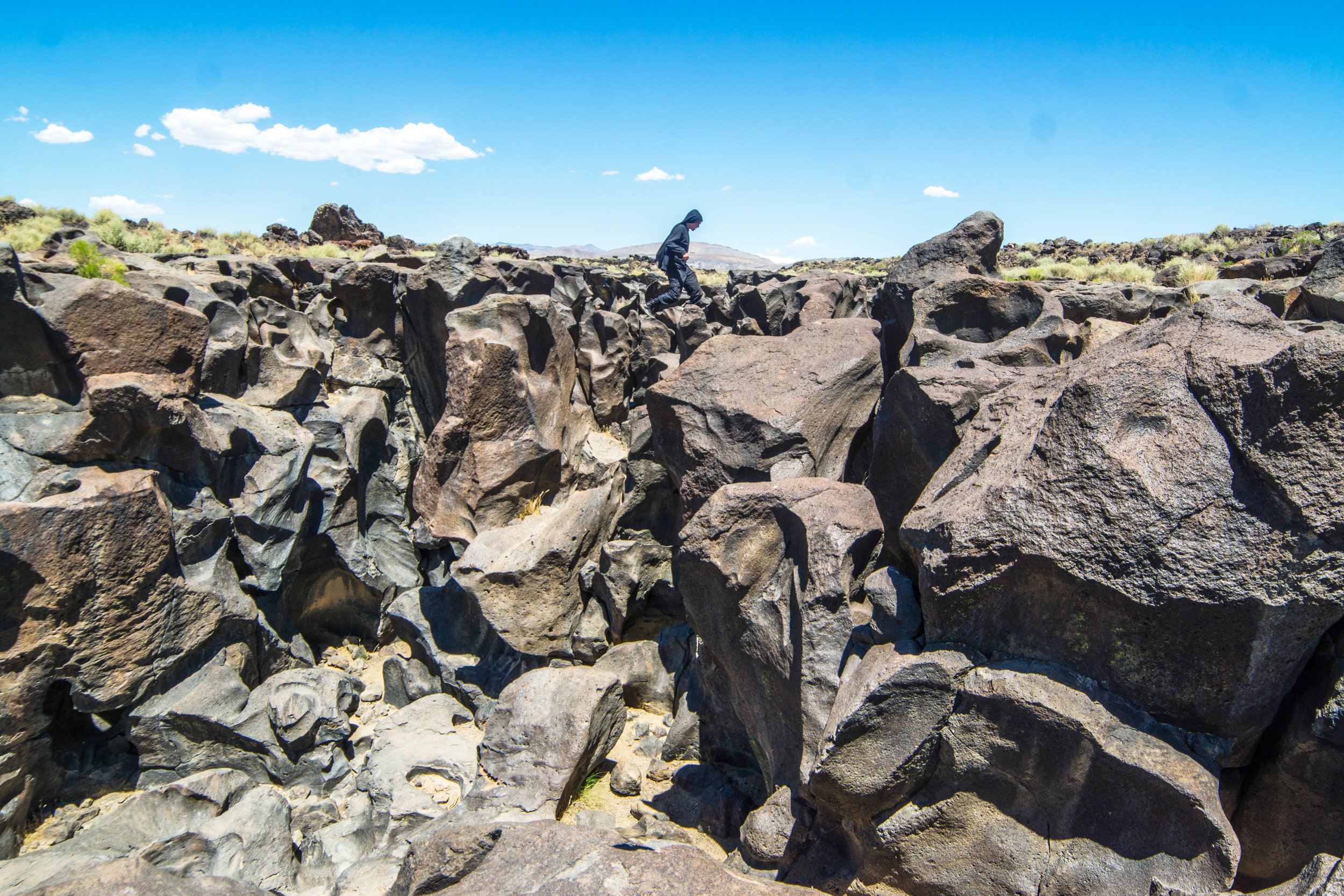 We briefly hop along the hardened magma before accepting defeat beneath the mid-afternoon desert sun.