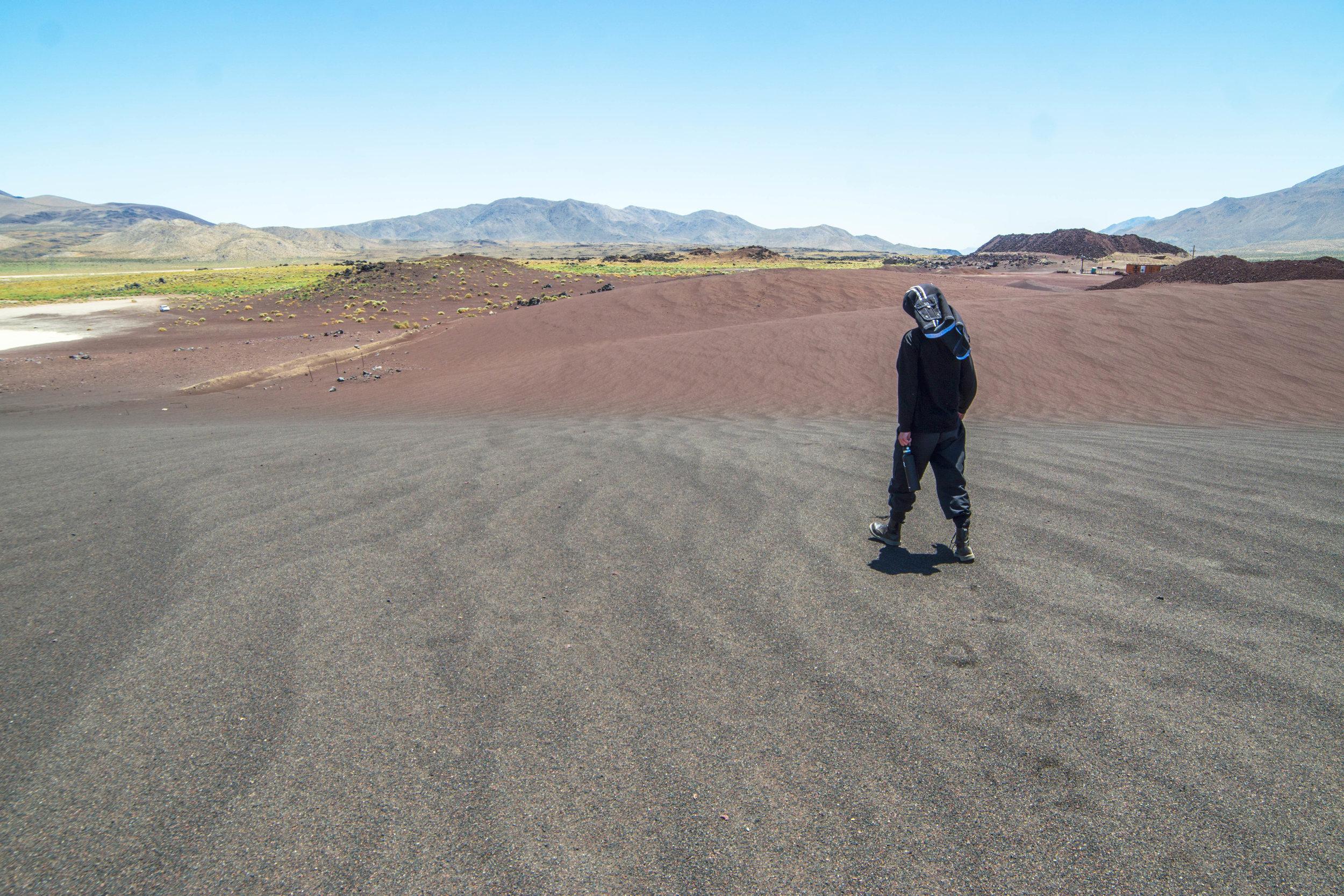 Like an alien planet, it has mars red & black sand dunes.